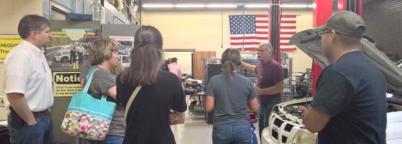 Click to enlarge,  Chuck Mann, CCCC Automotive Instructor, speaks to teachers attending the 3rd Annual Bridging Education and Careers Summer Symposium.
