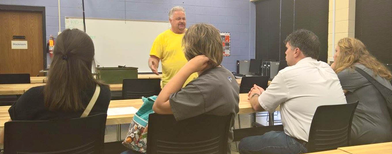 Click to enlarge,  Allen Howington, CCCC Industrial Systems Technology Chair, speaks to teachers attending the 3rd Annual Bridging Education and Careers Summer Symposium.