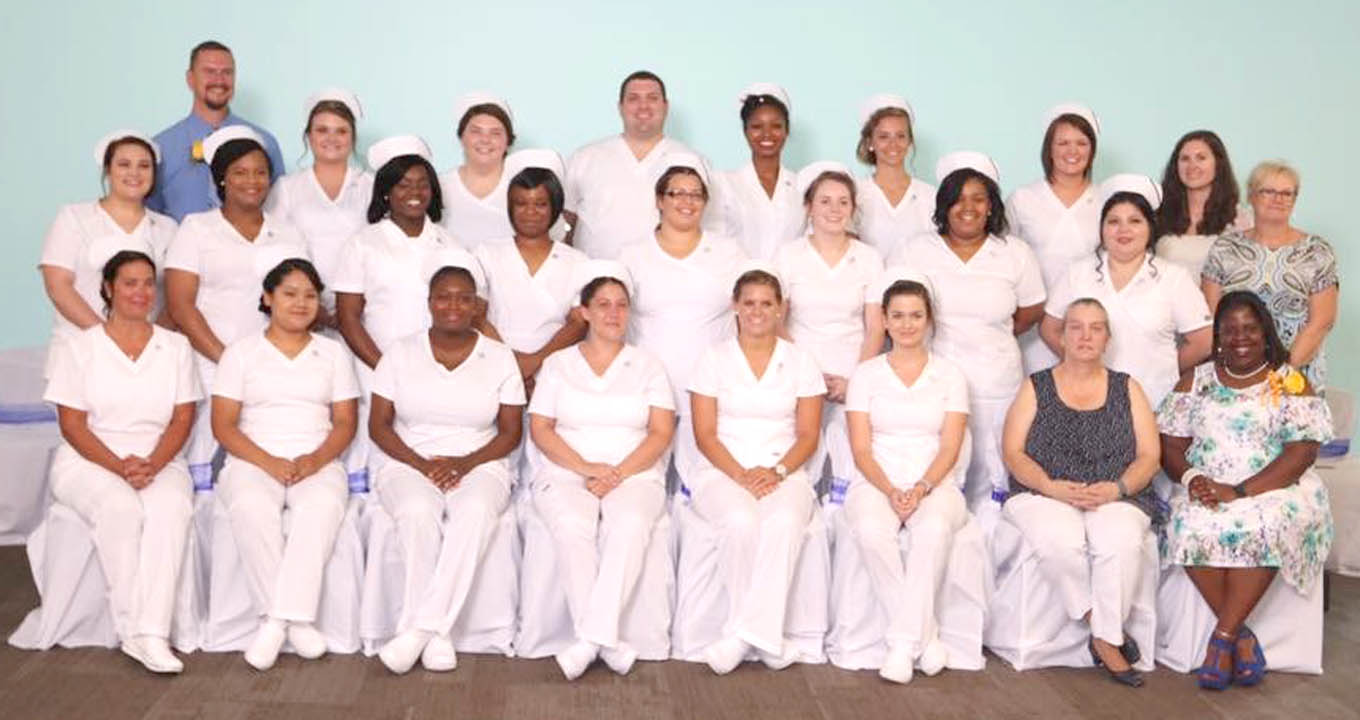 Click to enlarge,  The Central Carolina Community College Louise L. Tuller School of Nursing recently held a Pinning and Candle Lighting Ceremony for the Practical Nursing Class of 2017. The event was held at CCCC's Harnett Health Sciences Center in Lillington. Members of the class are pictured, left to right: front row: Dawn Nance of Angier, Liria Mateo of Angier, Sheila Blackwell of Chapel Hill, Katie Killette of Kenly, Madison Spinks of Moncure, Victoria Cashwell of Siler City, Terry Cebulski-Field (Instructor), and Consuela Blaizes (Course Coordinator/Instructor); second row, Caroline Wasguespack of Parkton, Lashanda Davis of Dunn, Janaye Bullock of Fayetteville, Audrey Swann of Sanford, Whitney Nettles of Siler City, Kaitlin Everette of Erwin, Tatrice Morris of Dunn, Ana Machuca of Sanford, and Barbara Campbell (Department Chair); back row, Chris Bailey (Instructor), Jessica Spell of Roseboro, Madison Bruehl of Sanford, William Wilson of Erwin, Shakera Haynes of Fayetteville, Haley McMillan of Fayetteville, Emily Holleman of Angier, and Kasey Patterson (Administrative Assistant). Not pictured is Joseph Legrande of Durham. For more information on the CCCC Louise L. Tuller School of Nursing, visit www.cccc.edu/nursing.
