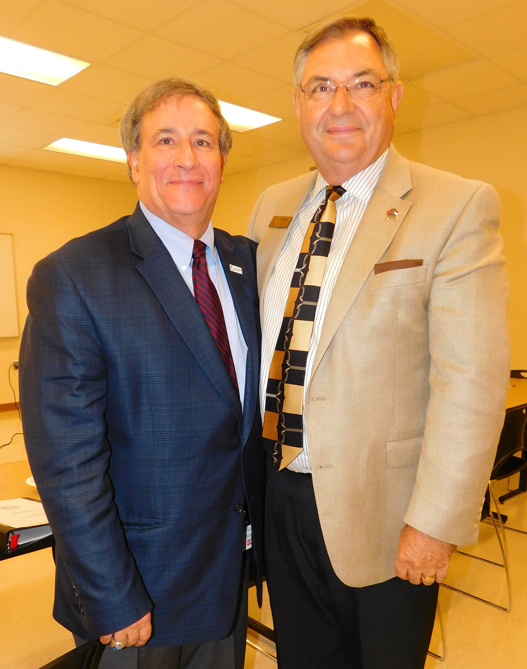 Click to enlarge,  Julian Philpott (left) and Jim Burgin have been reappointed as Chairman and Vice Chairman, respectively, of the Central Carolina Community College Board of Trustees for 2017-2018.