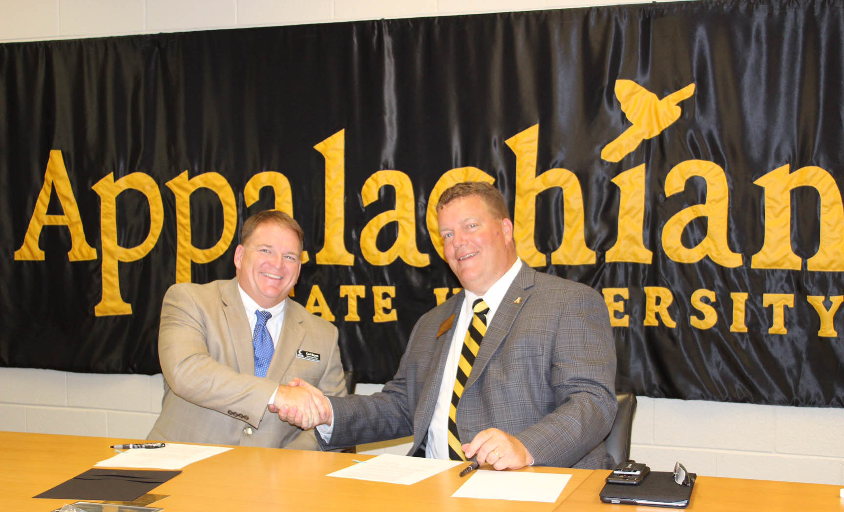 "Click to enlarge,  Central Carolina Community College's Health and Fitness Science program recently joined an articulation agreement with Appalachian State University. Carl Bryan (left), CCCC Health and Fitness Science Program Director, and Dr. Mark Ginn, ASU Vice Provost for Undergraduate Education, signed the agreement. ""I am very excited for our Health and Fitness Science students for this new articulation agreement. It provides yet another pathway for our students to continue their education after obtaining an Associate in Applied Science degree here at Central Carolina,"" said Bryan, who noted that the CCCC Health and Fitness Science program also has articulation agreements with UNC-Wilmington and N.C. Wesleyan College. ""The support of our Health and Fitness Science curriculum is overwhelming at ASU, and they have provided a seamless transfer for our Associate in Applied Science students to enter into their pursuit of a Bachelor's degree at ASU. The work we are doing in the classroom and labs at CCCC works in concert with what ASU is doing in their Bachelor's degree in Exercise Science."" For more information on the CCCC Health and Fitness Science program, contact Program Director Carl Bryan at 919-718-7554 or by email at cbryan@cccc.edu."