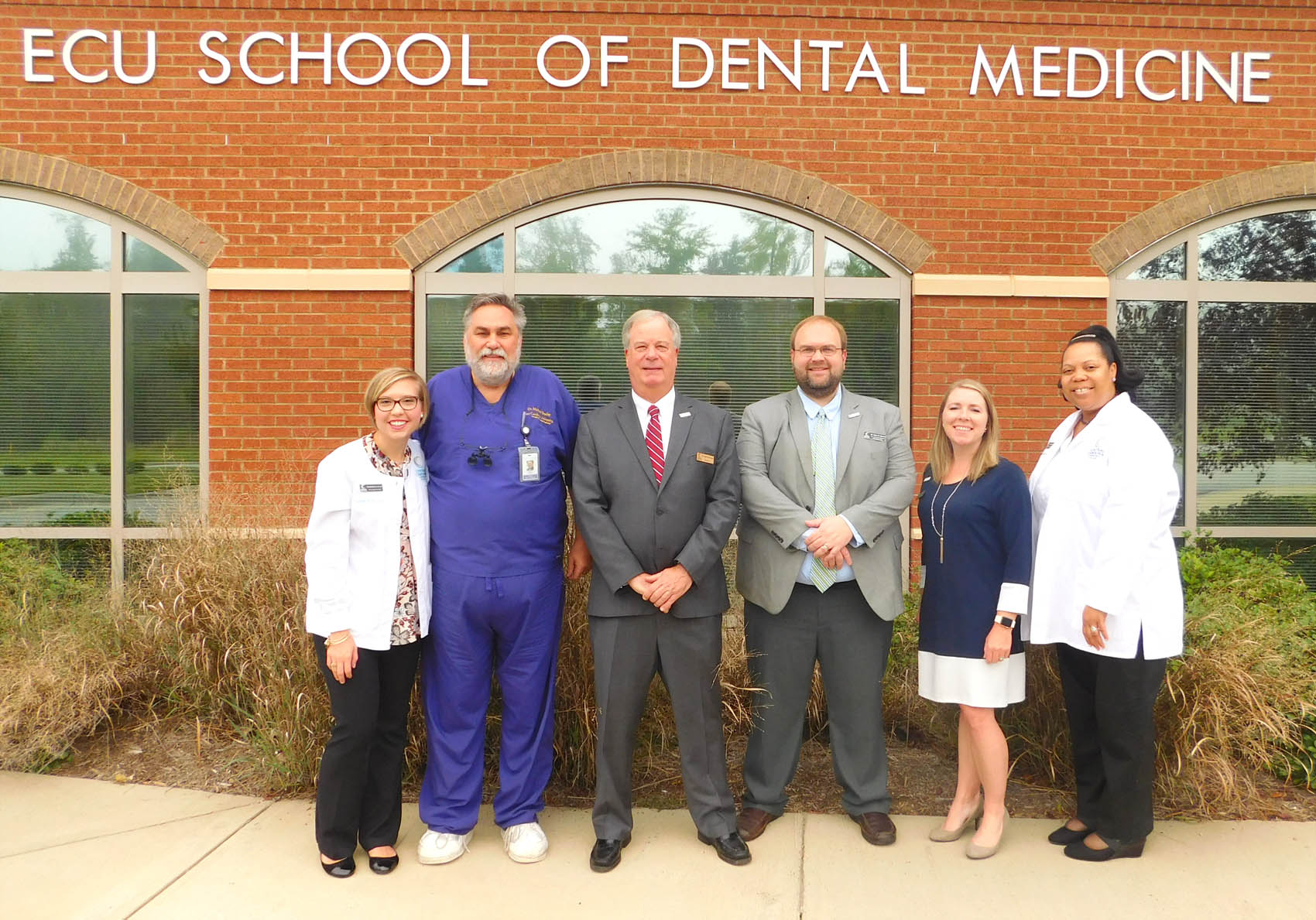 Click to enlarge,  The Central Carolina Community College Dental Programs have begun a new partnership with the East Carolina University School of Dental Medicine's Community Service Learning Center in Lillington. Pictured are, left to right: Danielle Bruner, CCCC Dental Hygiene Clinical Coordinator/Instructor; Dr. Michael Bradley, Clinical Assistant Professor and Director of Dentistry with the ECU School of Dental Medicine's Community Service Learning Center in Lillington; Dr. T. Eston Marchant, CCCC President; Dr. Brian Merritt, CCCC Vice President of Learning and Workforce Development; Lisa Godfrey, CCCC Dean of Health Sciences and Human Services; and Dr. Fernanda Perry, CCCC Dental Assisting/Hygiene Instructor.