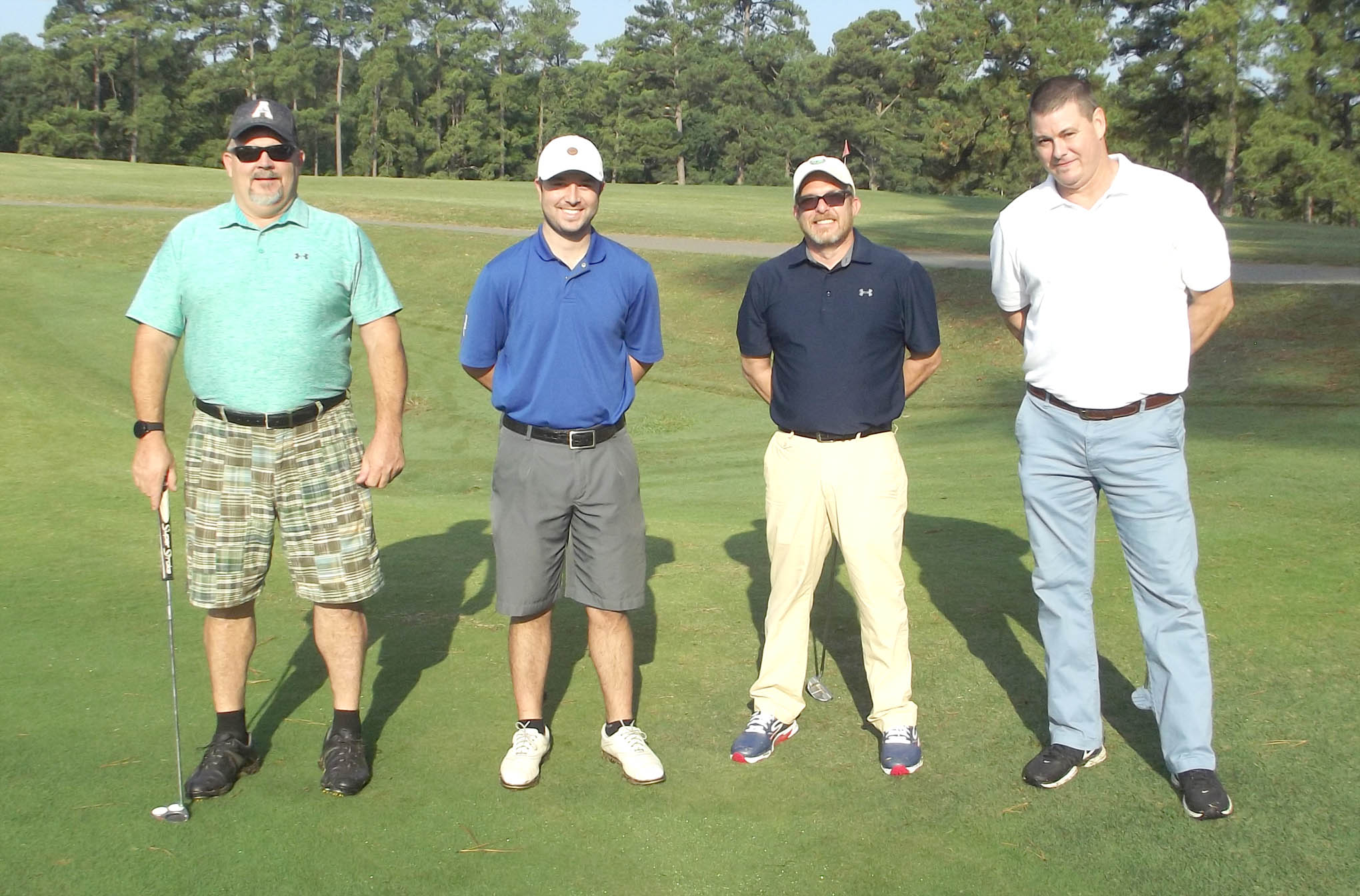 Click to enlarge,  The team of Micah Lawrence, Bo Crooks, Dale Bunnell, and Ray Blackburn won the second flight of the morning tournament of the CCCC Foundation Lee Golf Classic.