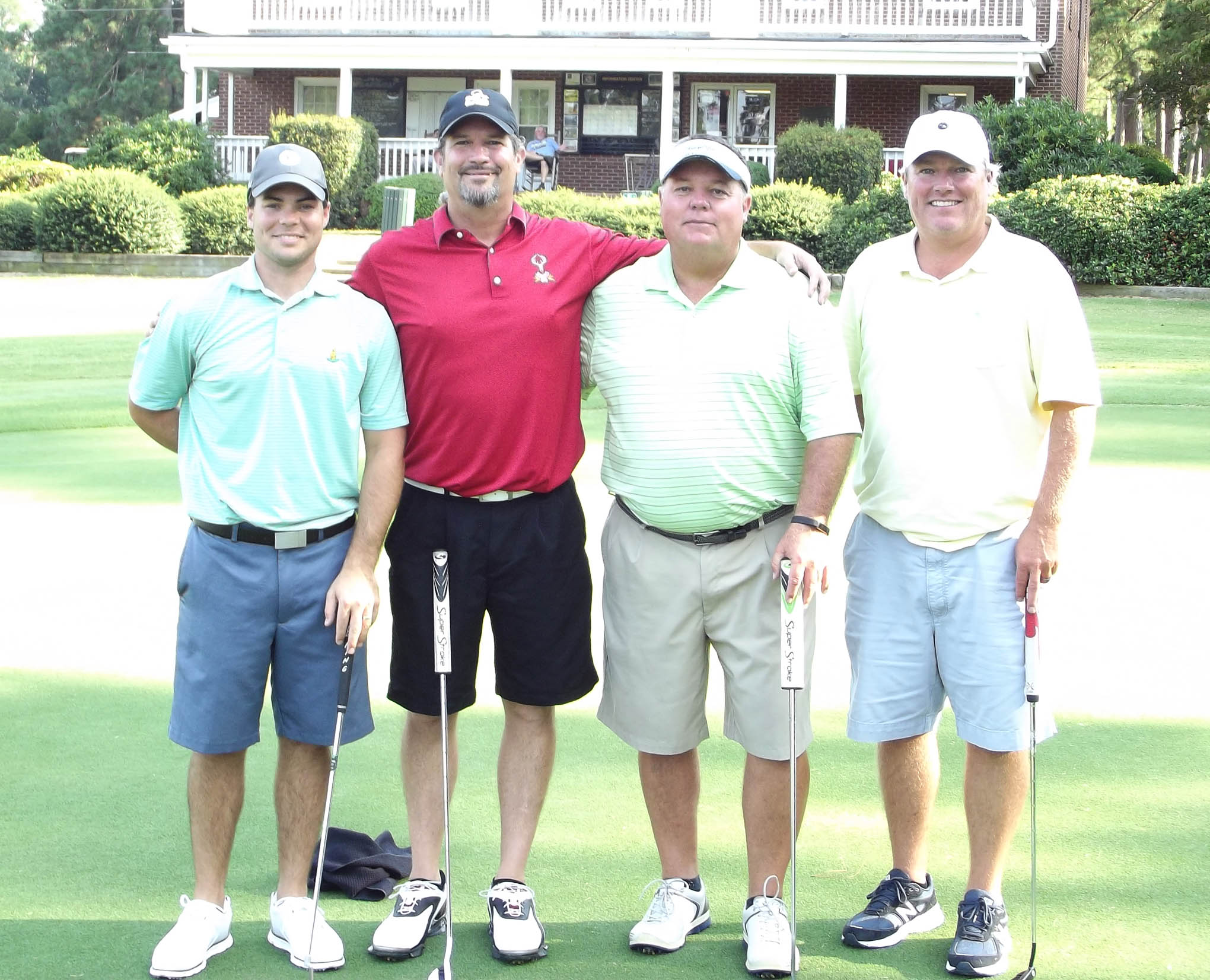 Click to enlarge,  The team of Andy Phillips, Wayne Freeman Jr., Tripp Brizendine, and Robin Williams won the first flight of the afternoon tournament of the CCCC Foundation Lee Golf Classic.