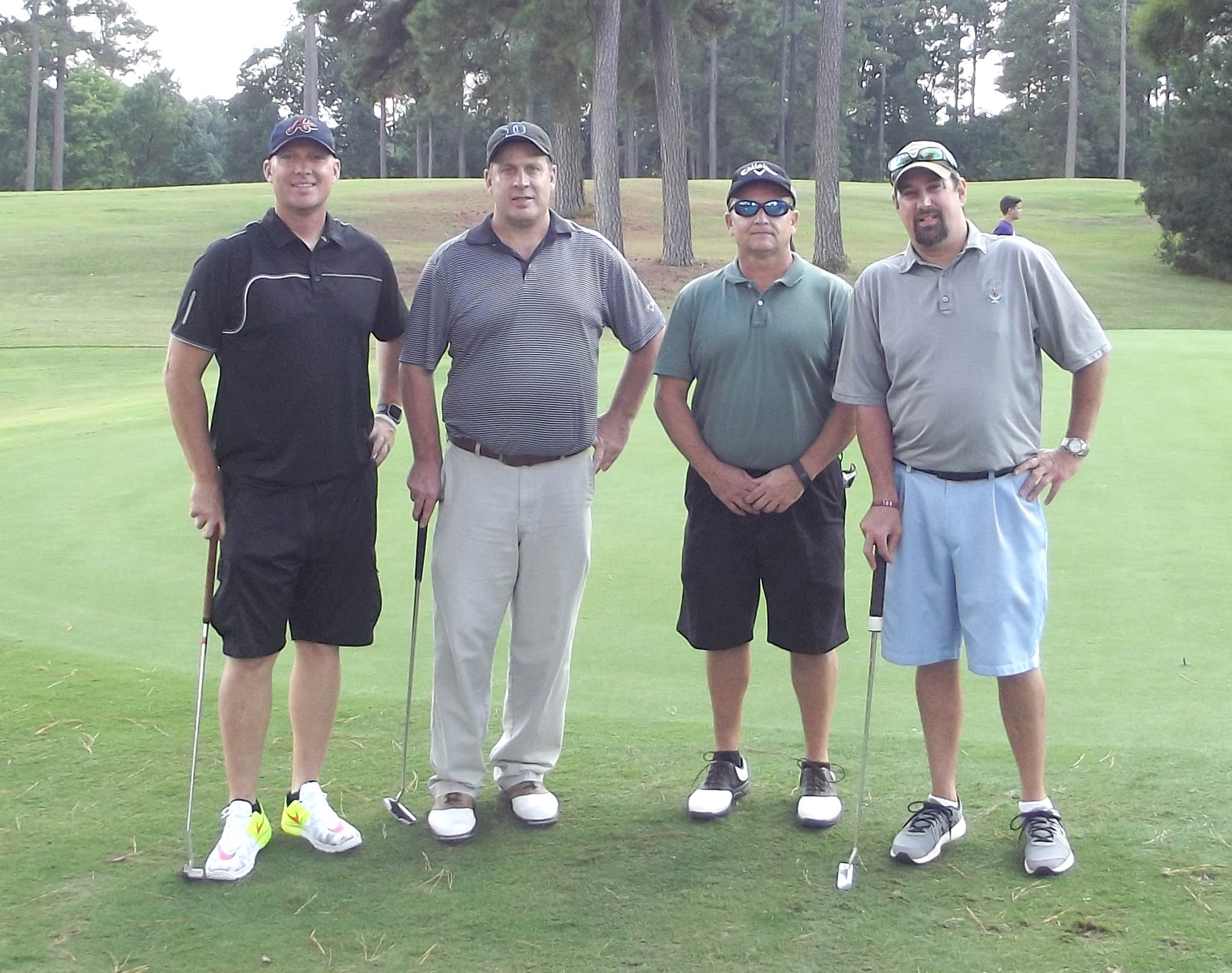 Click to enlarge,  The team of Jared Stimpson, Mitch Jacobs, Jimmy Whitaker, and Mark Midford won the third flight of the afternoon tournament of the CCCC Foundation Lee Golf Classic.