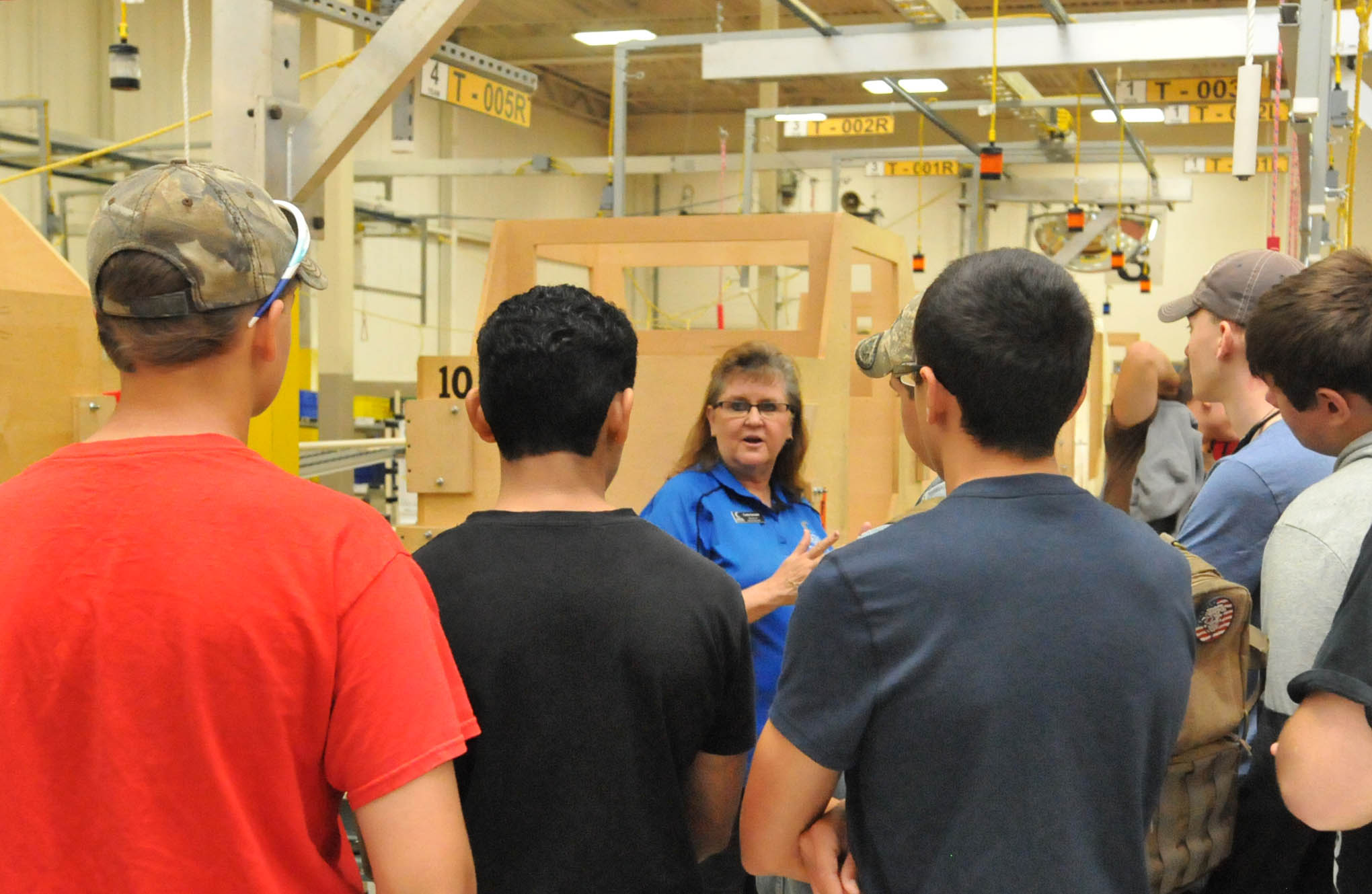 Click to enlarge,  Central Carolina Community College Director of Industry Services Cathy Swindell speaks to students at National Manufacturing Day at CCCC's Dr. Paul Howard and Dr. Barbara James Innovation Center.