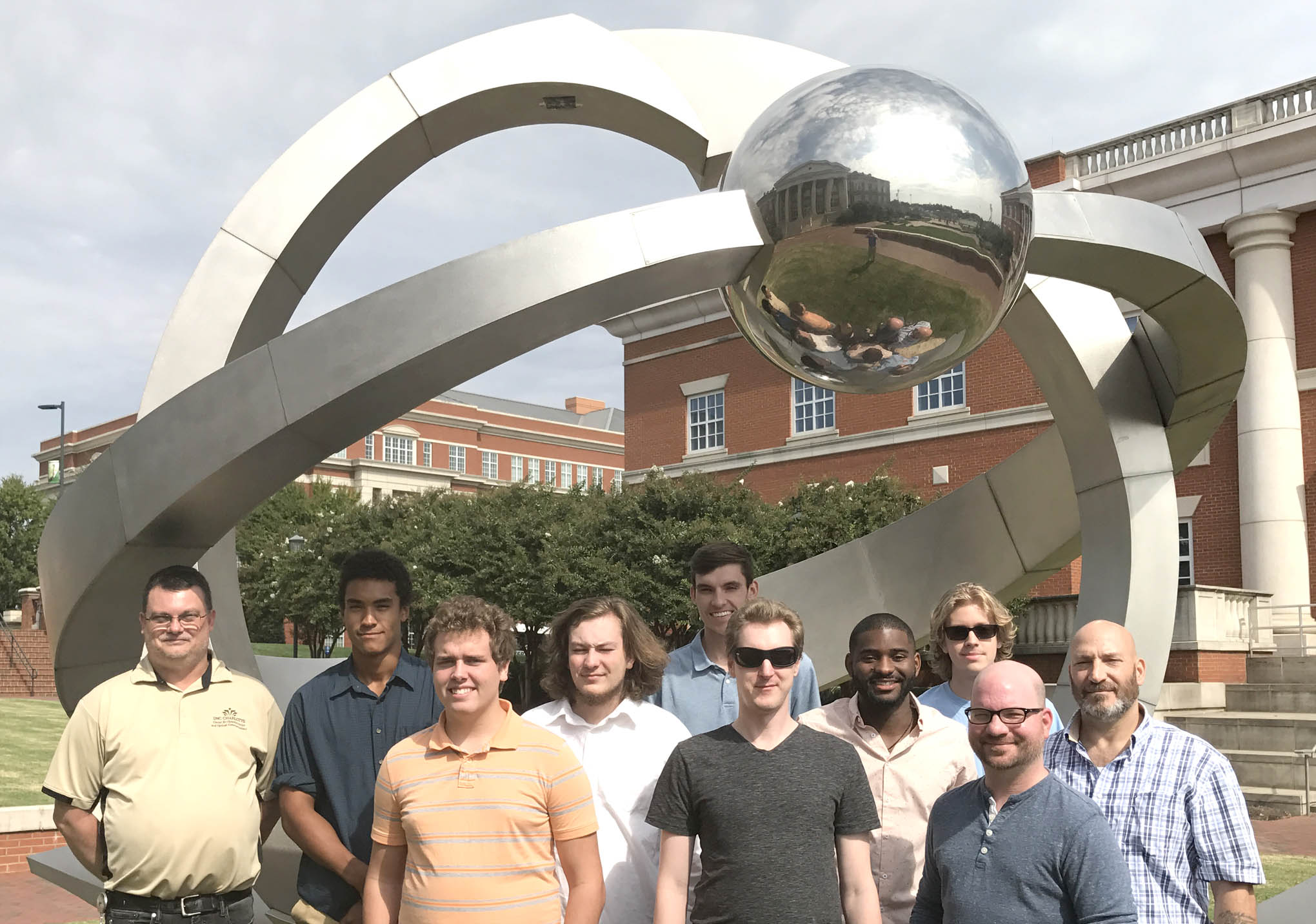 Click to enlarge,  Touring the Optics Research Center on the University of North Carolina at Charlotte's campus were, left to right: Scott Williams (Assistant Director of the Center, who is an advisor to the CCCC LPT program), Brandon Pasley Disher, Derrick Kuhl, Darin Anderson, Cody Flowers, Michael Kropp, Jamal Robinson, Seth Kuenzler, Nickolas Jorgenson, and Richard Dickens.