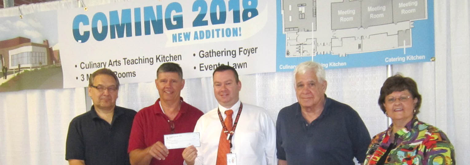 Click to enlarge,  The North Carolina Academy of Small Animal Medicine, in appreciation of the Dennis A. Wicker Civic Center's service to the organization's statewide seminars over the years, has donated $1,000 to go toward the ongoing Civic Center expansion and renovations.  Pictured are, left to right: Dr. David Krakowski, Dr. Roy McDonald, Civic Center Director David Foster, Dr. Steve Jasse, and Civic Center Coordinator Kay Faucette.