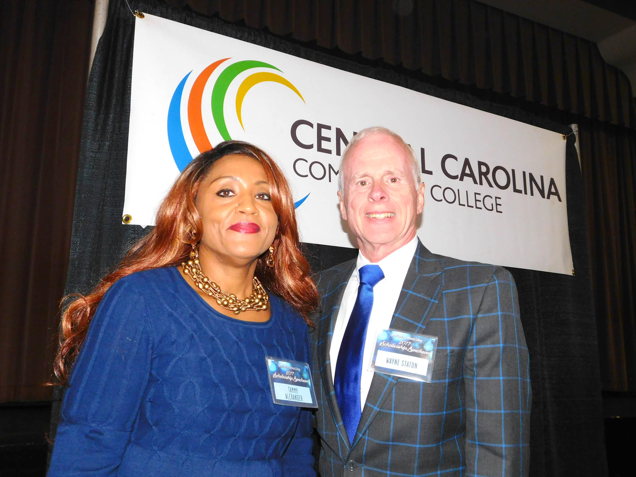 Click to enlarge,  Wayne Staton (right) visits with CCCC scholarship recipient Tammy Alexander during Central Carolina Community College's Scholarship Luncheon on Wednesday, Nov. 15, at the Dennis A. Wicker Civic Center. Staton was in attendance to represent the Allyn Moore Staton Memorial Scholarships and the William W. and Ellen B. Staton Paralegal Scholarships.