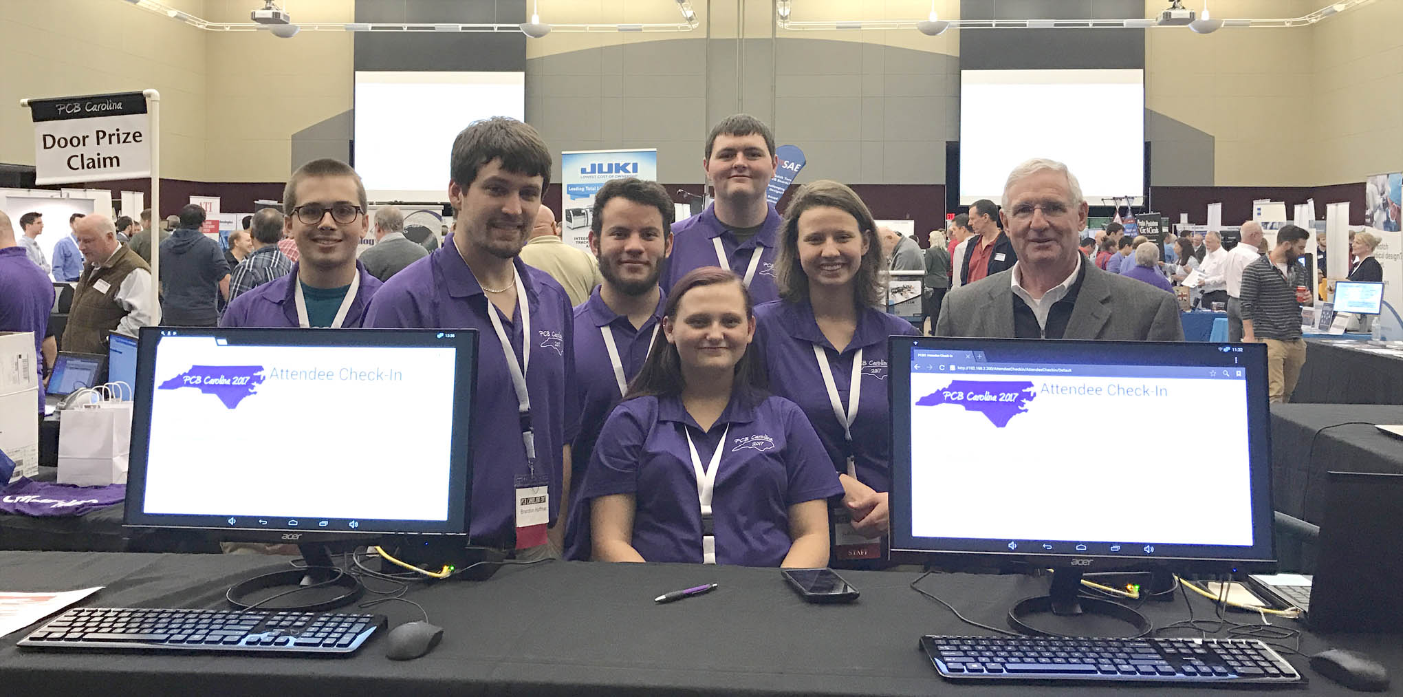 Click to enlarge,  Among the Central Carolina Community College Laser and Photonics Technology program attendees at the PCB Carolina 2017 Electronics Trade Show and Technical Conference were, left to right: Jamie Turner, Brandon Huffman, Cameron Wiedholz, Brittany Cheek, Ian Washburn, Isabelle Karis, and Gary Beasley (Lead Instructor of the CCCC Laser and Photonics Technology program).