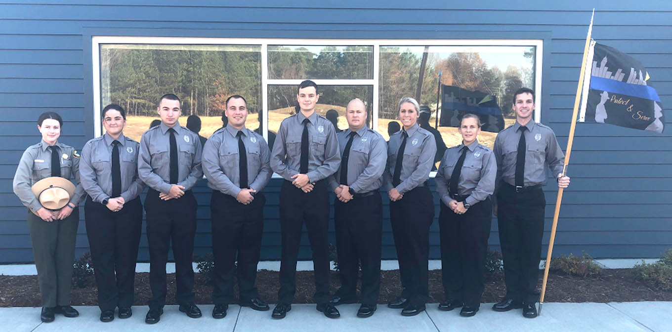 Click to enlarge,  Pictured are members of Central Carolina Community College's Basic Law Enforcement Training (BLET) Fall 2017 graduating class. Pictured are, left to right: Lindsey Purvis, Johnsie Holbrook, Ryan Jollie, Cody Roberts, Kyle Moore, Ian Scott, Olivia Sturdivant, Jayne Holland, and Maximillian Hogan. For more information about the college's BLET program, visit www.cccc.edu/blet or contact Robert Powell at rpowell@cccc.edu or 919-777-7774.
