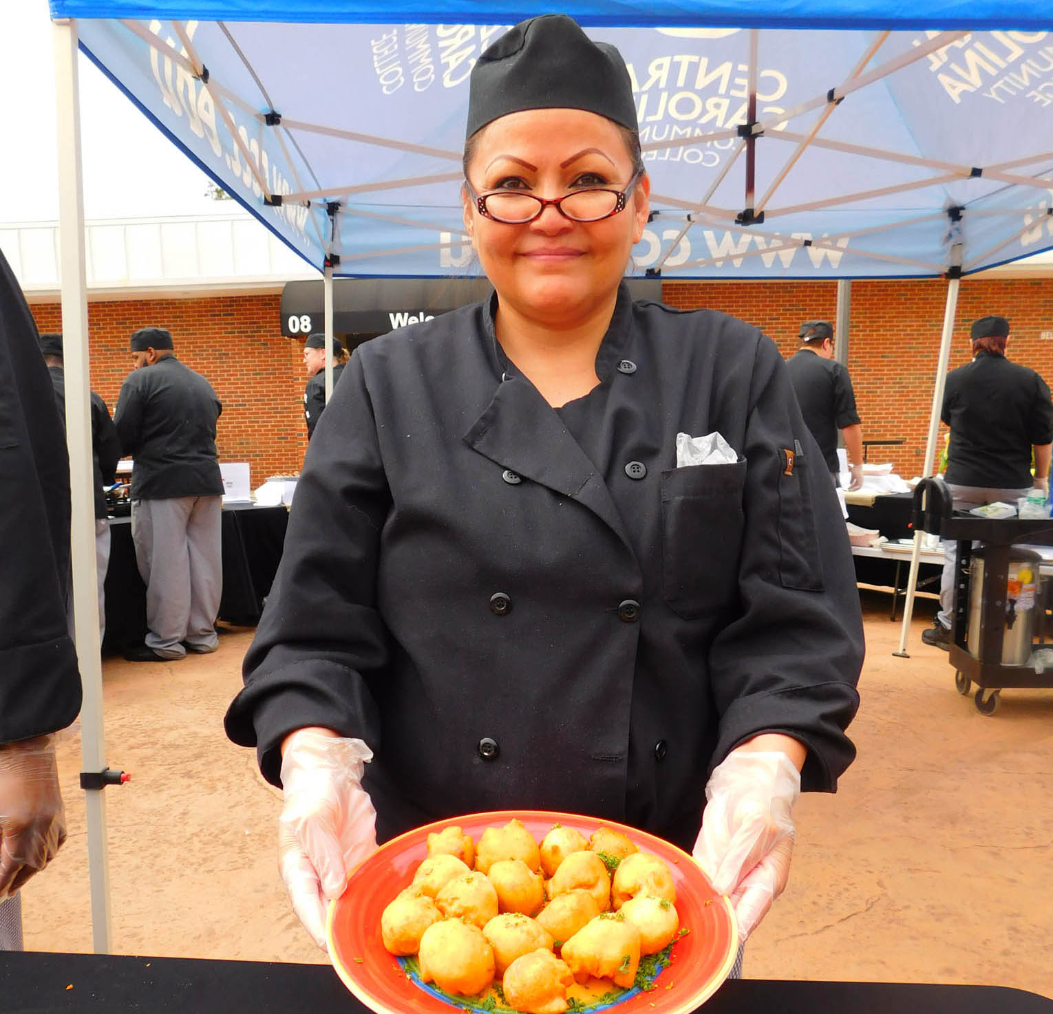Click to enlarge,  Doni Shepard Steele, of Siler City, with her Bacon Pimento Cheese Bombs, won the People's Choice Award at the Central Carolina Community College 3rd Annual Culinary Showcase. The event, featuring dishes by Culinary & Hospitality Arts students represented from Chatham, Harnett, and Lee counties, was held April 11th on the Central Carolina Community College Lee Main Campus in Sanford. For more information on the CCCC Culinary & Hospitality Arts program, visit www.cccc.edu/culinaryarts/.