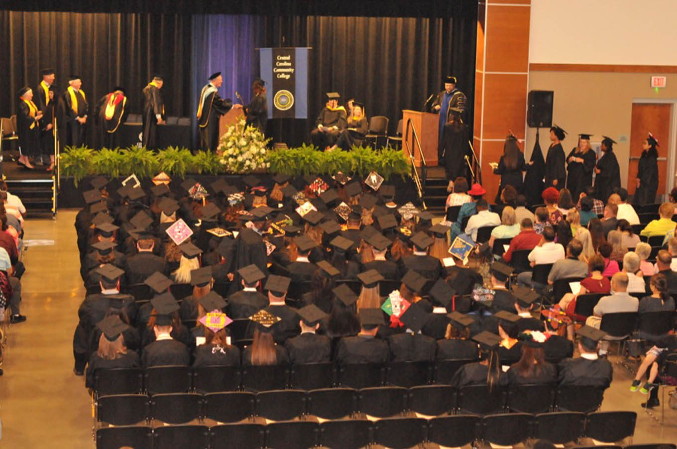Click to enlarge,  Central Carolina Community College celebrated the achievements of the Class of 2018 as the school observed its 55th Commencement Exercises on May 10 at the Chatham County Agriculture & Conference Center.