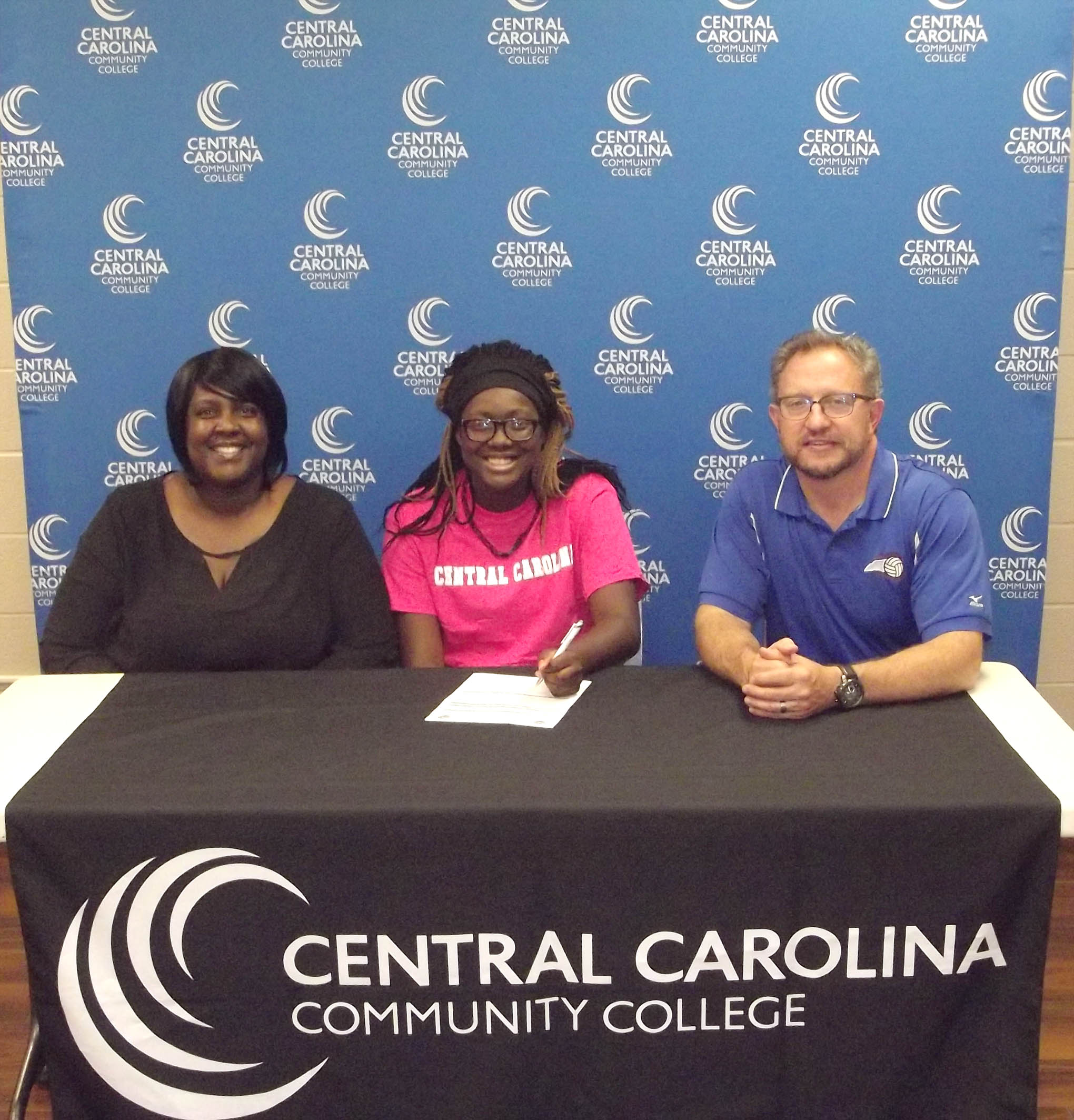 Click to enlarge,  Daylene Thompson, of Laney High School in Wilmington, signs with the Central Carolina Community College women's basketball program. For more information about Central Carolina Community College and its programs, visit its website, www.cccc.edu or call the college at 919-775-5401.
