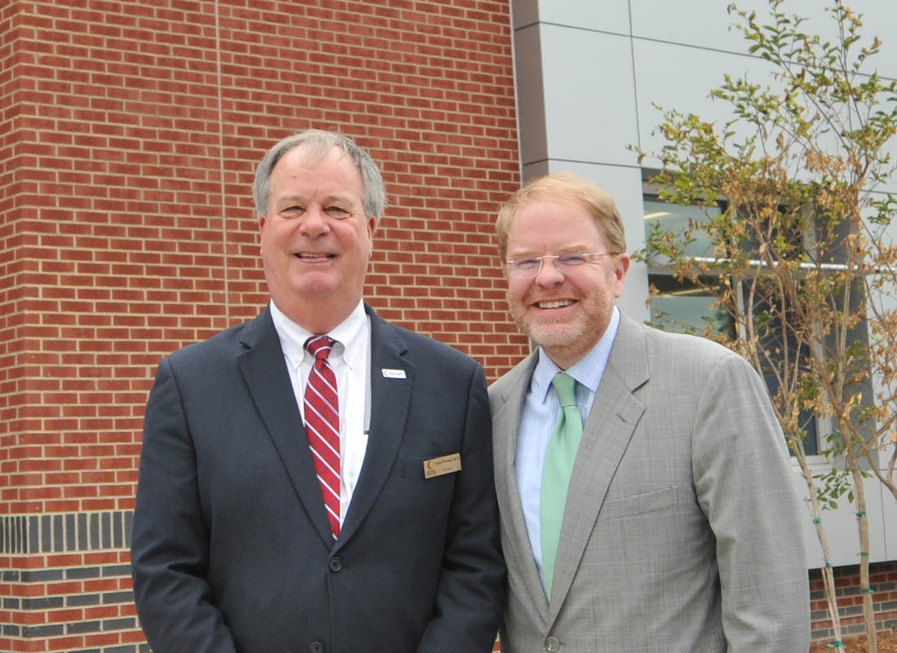 Click to enlarge,  Central Carolina Community College President Dr. T.E. Marchant (left) visits with N.C. Community College System President Peter Hans at the CCCC Grand Celebration for the opening of the new Oscar A. Keller Jr. and Elderlene R. Keller Health Sciences Building and the expansion of the Dennis A. Wicker Civic Center.