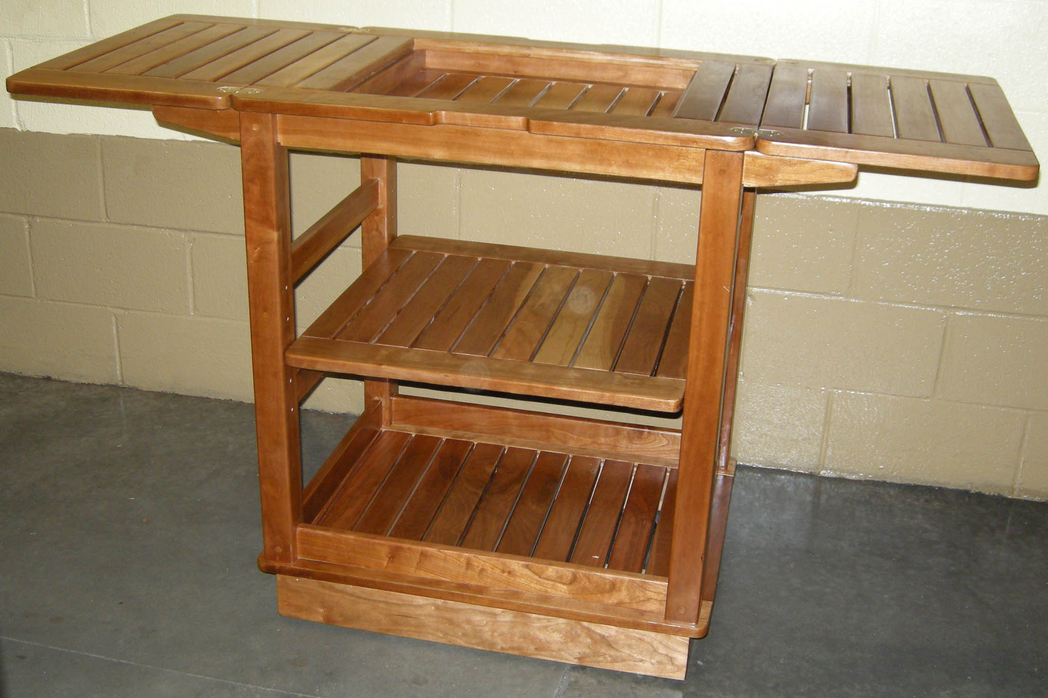 Click to enlarge,  This beautiful cherry kitchen cart will be among the items up for bid at the Central Carolina Community College Foundation's 18th Annual Furniture Auction Saturday, June 2, in the Multipurpose Room of the Miriello Building on the college's Harnett County Campus, 1075 E. Cornelius Harnett Blvd. Viewing and registration starts at 9 a.m. and bidding, at 10 a.m. For more information about the CCCC Foundation Furniture Auction, call 910-893-9101 or go online to www.cccc.edu/auction to see a photo gallery of the auction pieces.