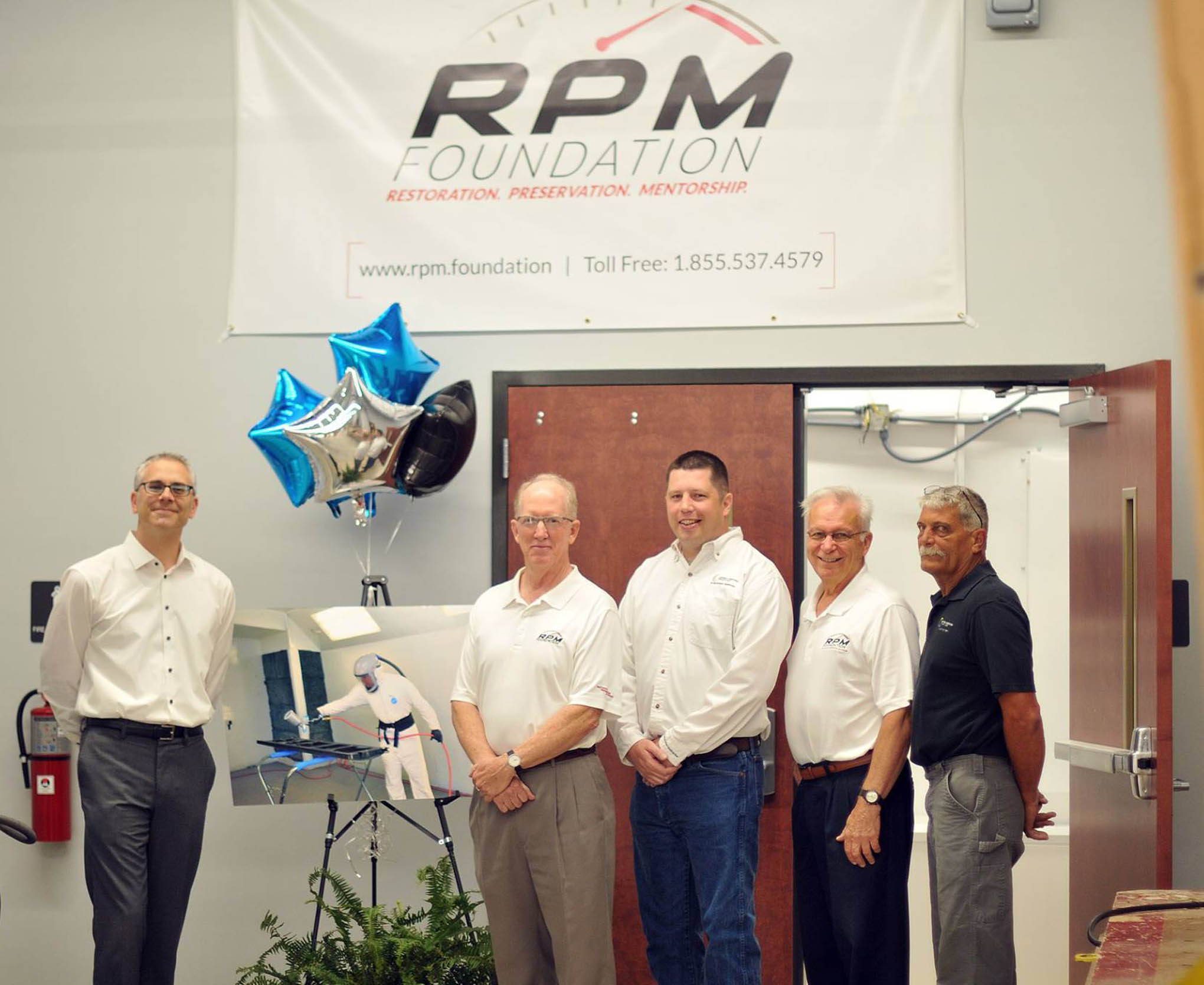 Click to enlarge,  RPM Foundation officials attended the Central Carolina Community College ribbon cutting to celebrate the opening of the West Harnett Center Automotive Restoration Facility on Thursday, Aug. 9.