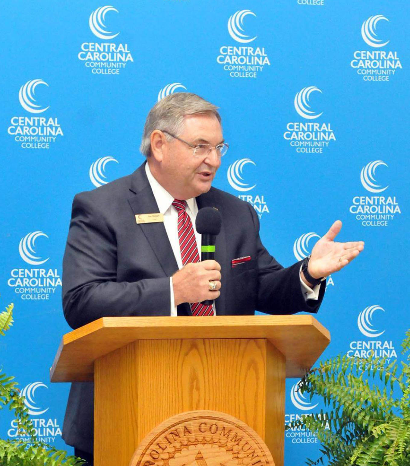 Click to enlarge,  Jim Burgin, Vice Chair of the Central Carolina Community College Board of Trustees, spoke to attendees at the ribbon-cutting event to celebrate the opening of the West Harnett Center Automotive Restoration Facility.