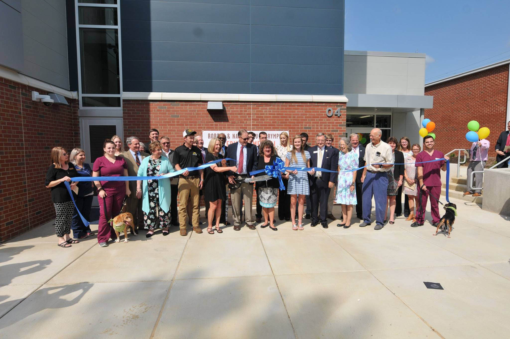 Click to enlarge,  Members of the Robert and Nannie Lou Dalrymple Family were present for the ribbon-cutting event to celebrate the opening of the Robert and Nannie Lou Dalrymple Veterinary Medical Technology Building on Monday, Aug. 13.