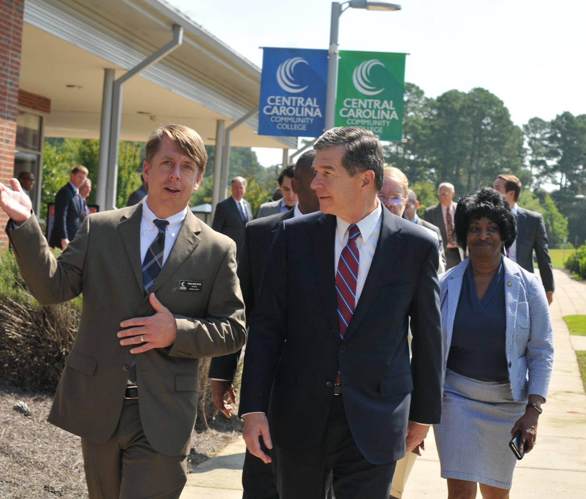 Click to enlarge,  Central Carolina Community College Chatham Provost Dr. Mark Hall (left) escorts N.C. Gov. Roy Cooper on a tour of the CCCC Chatham Main Campus in Pittsboro on Thursday, Aug. 23.