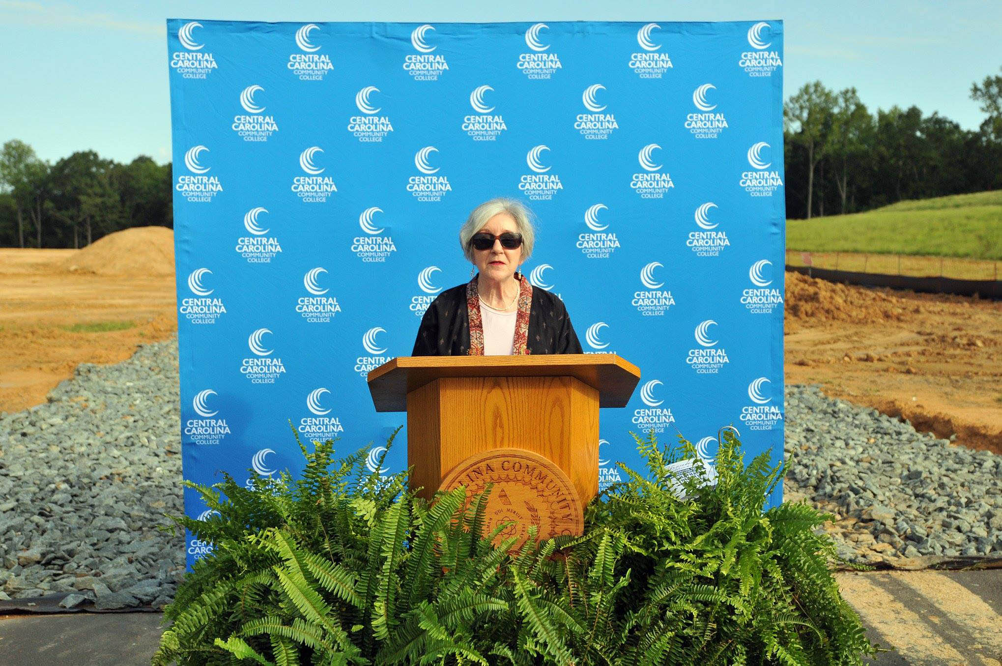 Click to enlarge,  Diana Hales, Chair of the Chatham County Board of Commissioners, spoke to attendees at the college's groundbreaking ceremony on Aug. 22 for the new Chatham Health Sciences Center.