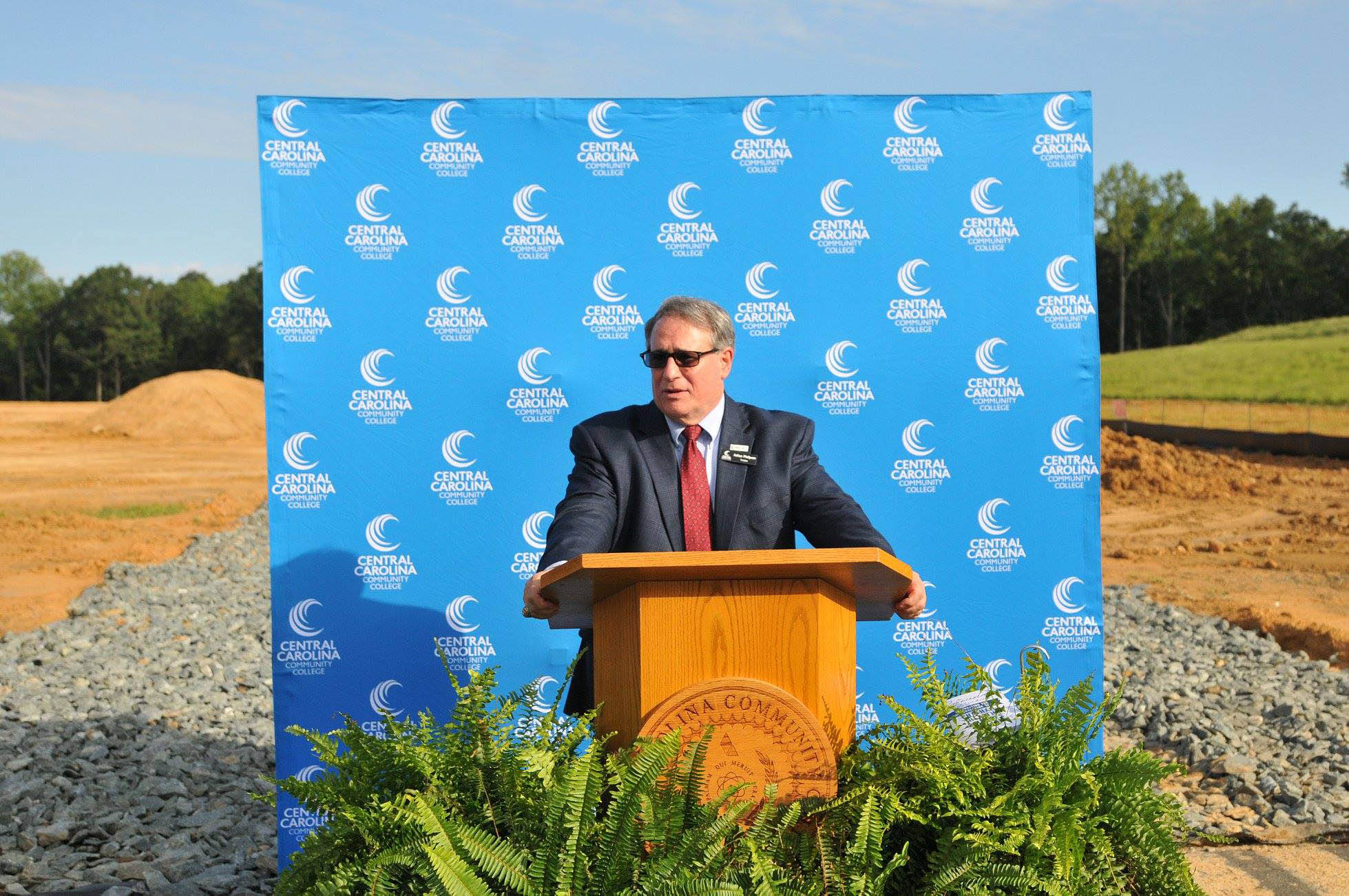 Click to enlarge,  Julian Philpott, Chairman of the Central Carolina Community College Board of Trustees, spoke to attendees at the college's Aug. 22 groundbreaking ceremony for the new Chatham Health Sciences Center.