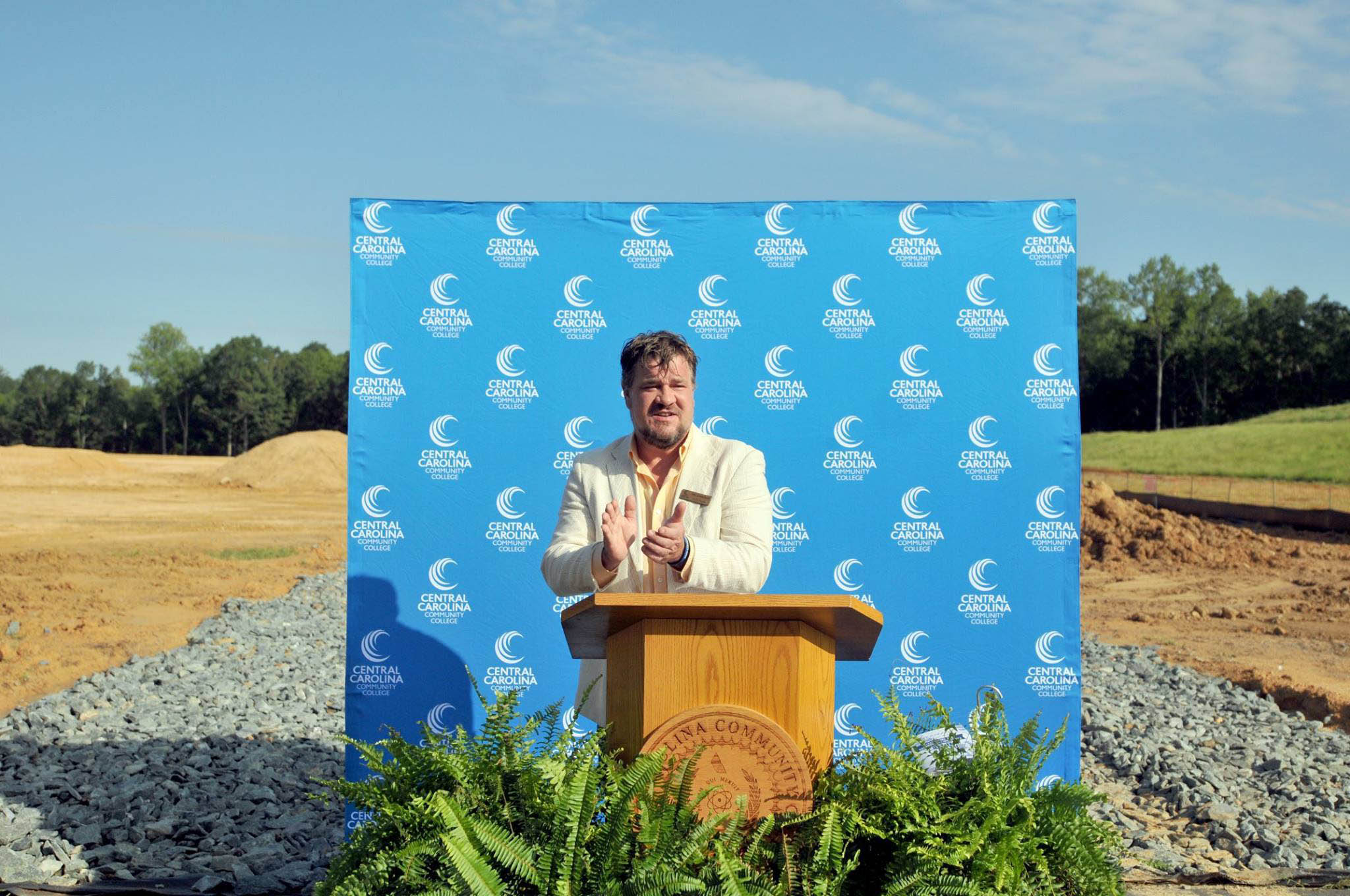 Click to enlarge,  Jim Crawford, member of the Chatham County Board of Commissioners and the CCCC Board of Trustees, spoke to attendees at the college's groundbreaking ceremony on Aug. 22 for the new Chatham Health Sciences Center.