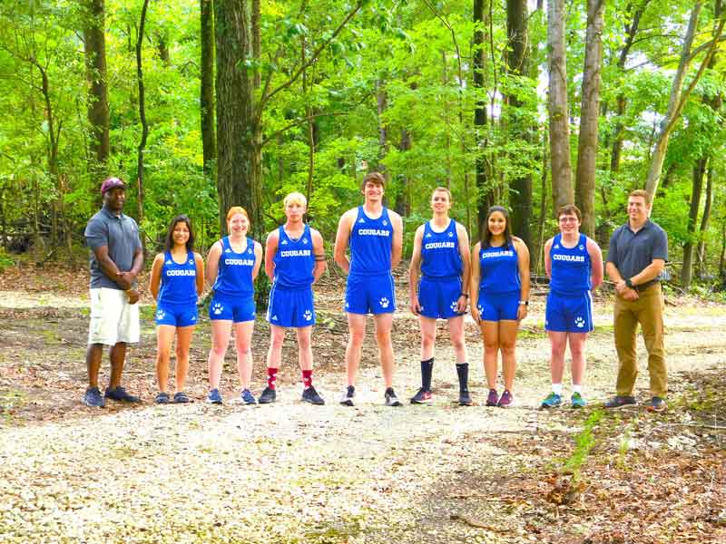 Click to enlarge,  Members of the 2018 Central Carolina Community College cross country team are pictured, left to right: Coach Cliff Scarborough, Nuvia Guardado, Alicia Walker, Britt Lehman, Seth Hoyle, Issac Stoutland, Lupe Vasquez, Brent Holder, and Coach Jacob Ashworth. Not pictured: Grayson Lynch.