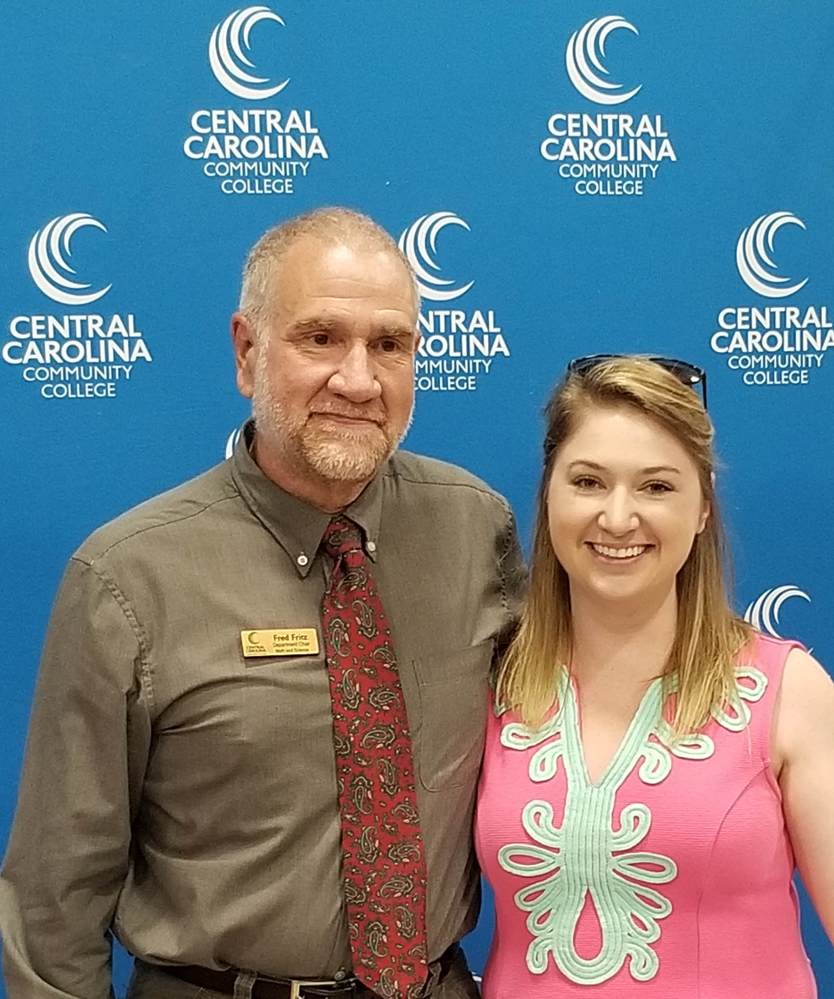 Click to enlarge,  Emma Belcher (right) has been named Central Carolina Community College Advisor of the Year. She is pictured with Fred Fritz, CCCC Dept. Chair, Math & Science. Belcher, who is a Biology instructor and has taught at CCCC since 2015, constitutes an unselfish devotion to students by contributing to their success by offering guidance as they begin their journey at CCCC.  For more information on Central Carolina Community College and its programs, visit www.cccc.edu.