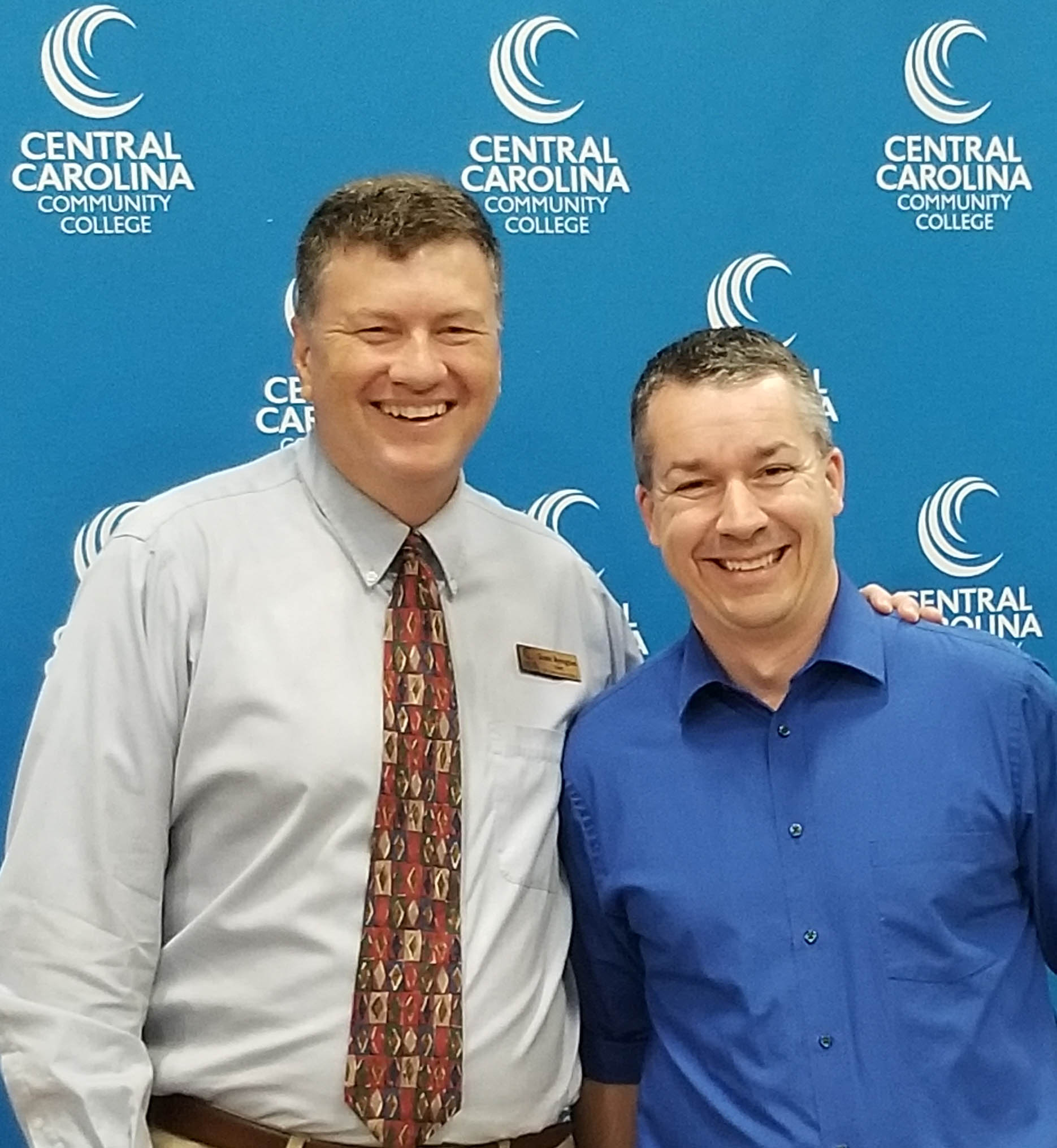 Click to enlarge,  Ty Stumpf (right) has been named Central Carolina Community College Advisor of the Year. He is pictured with Scott Byington, CCCC Dean of Arts, Sciences & Advising. Stumpf has been an advisor in the Associate in Arts (A.A.) program since 2001 and has been the program's chair since 2009. In his capacity as chair, Stumpf trains incoming A.A. advisors, he distributes materials to them, and mentors them as needed.  In addition, Stumpf facilitates numerous welcome sessions each year for new A.A. students.   For more information on Central Carolina Community College and its programs, visit www.cccc.edu.