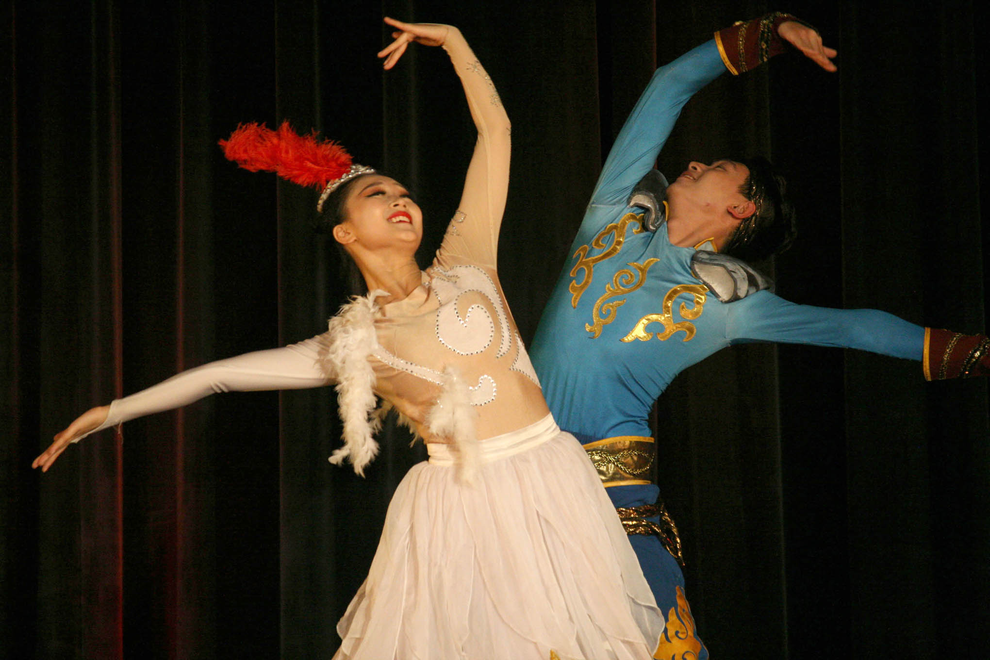 "Click to enlarge,  Dancers perform ""Stone Man and Swan"" during a free Chinese cultural program at the Dennis A. Wicker Civic & Conference Center. The dance is based on a legend from China's Kazakh ethnic group and expresses a longing for free and enthusiastic life."
