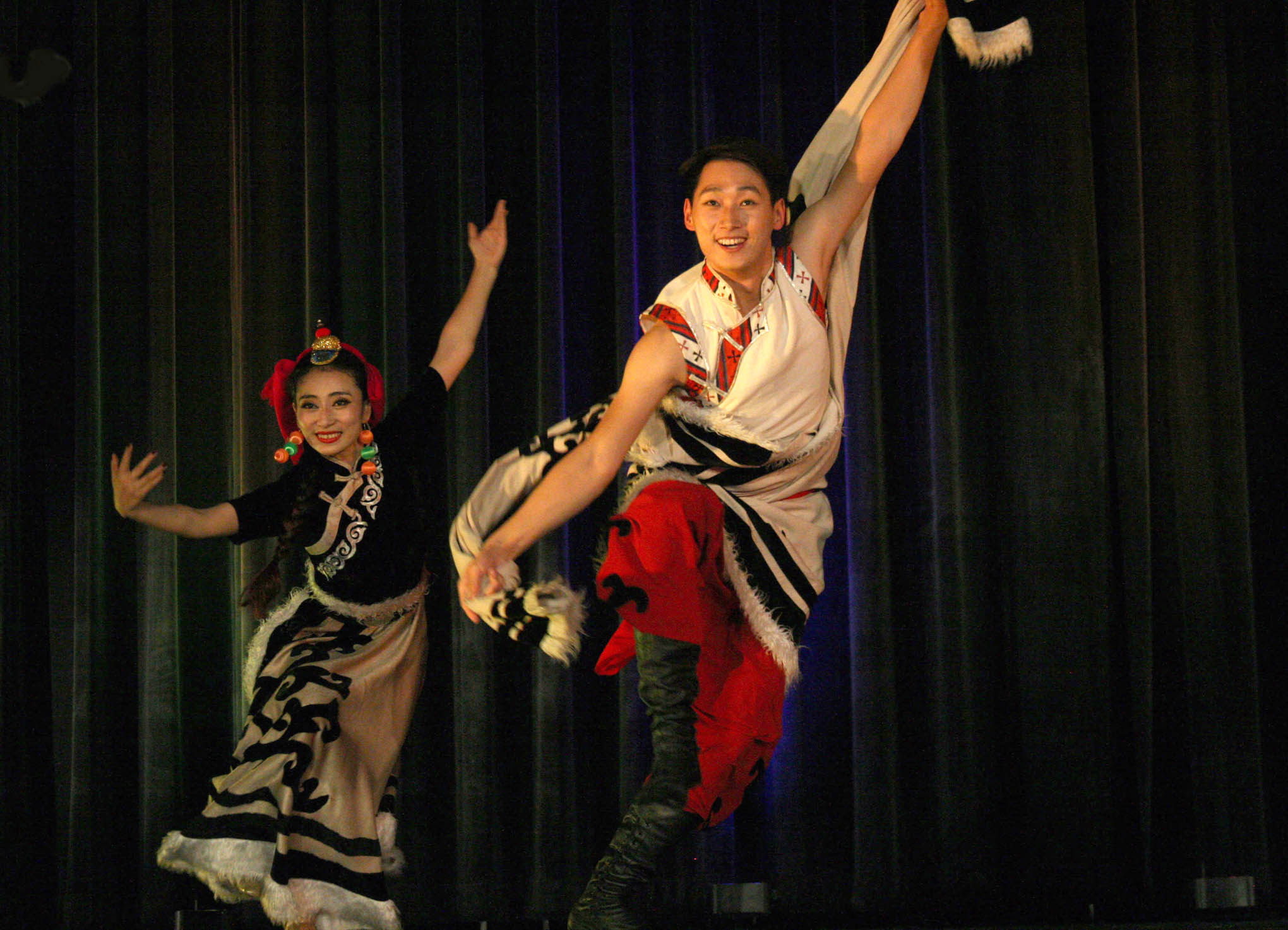 Click to enlarge,  High flying leaps dazzled local audiences during a Tibetan group dance performed by artists from China's South-Central University for Nationalities on their two-week United States tour.