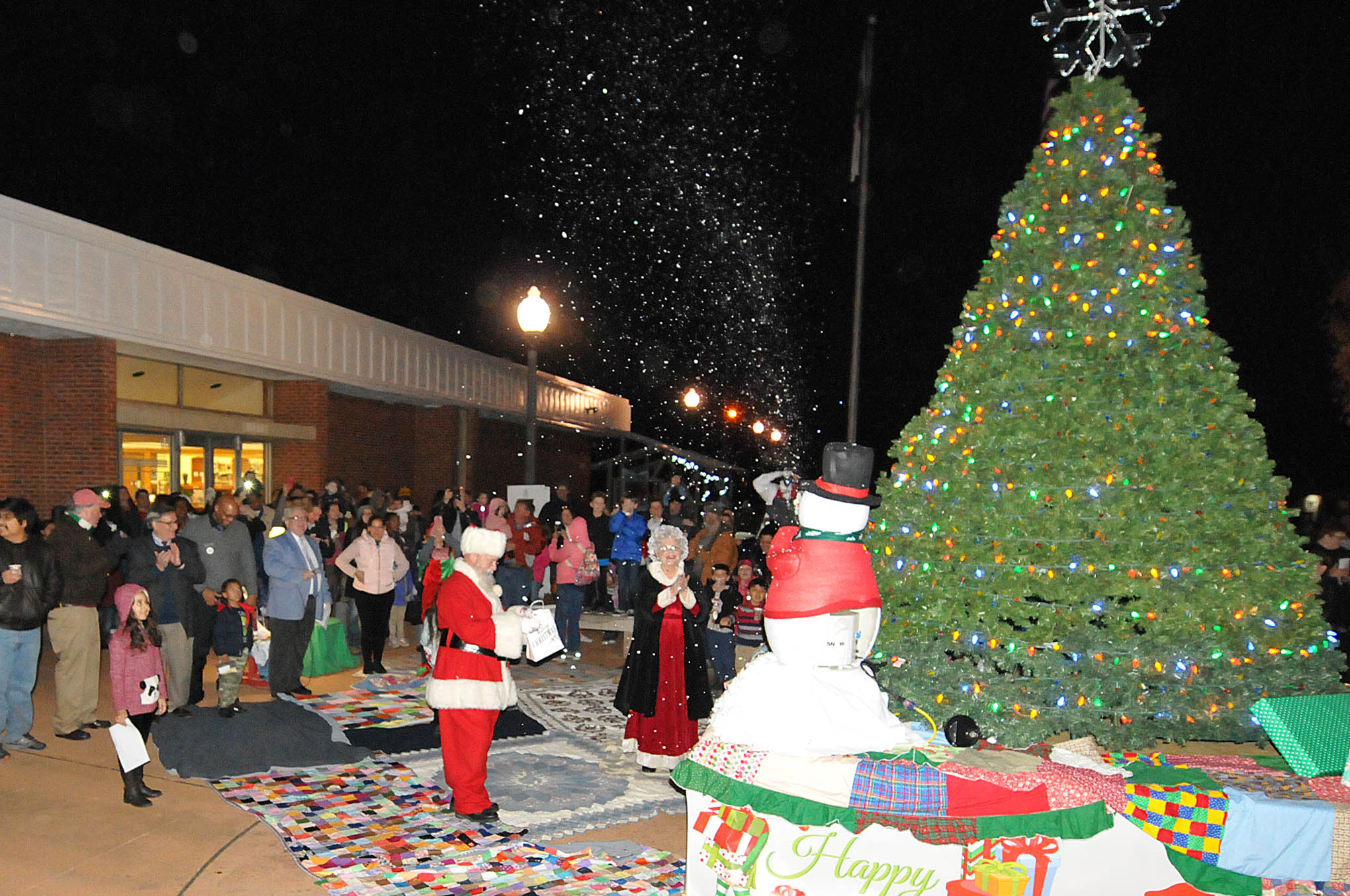 Click to enlarge,  Children and their families counted down to the moment when the Christmas tree suddenly glowed with its bright lights at the CCCC Foundation Christmas Tree Lighting celebration.