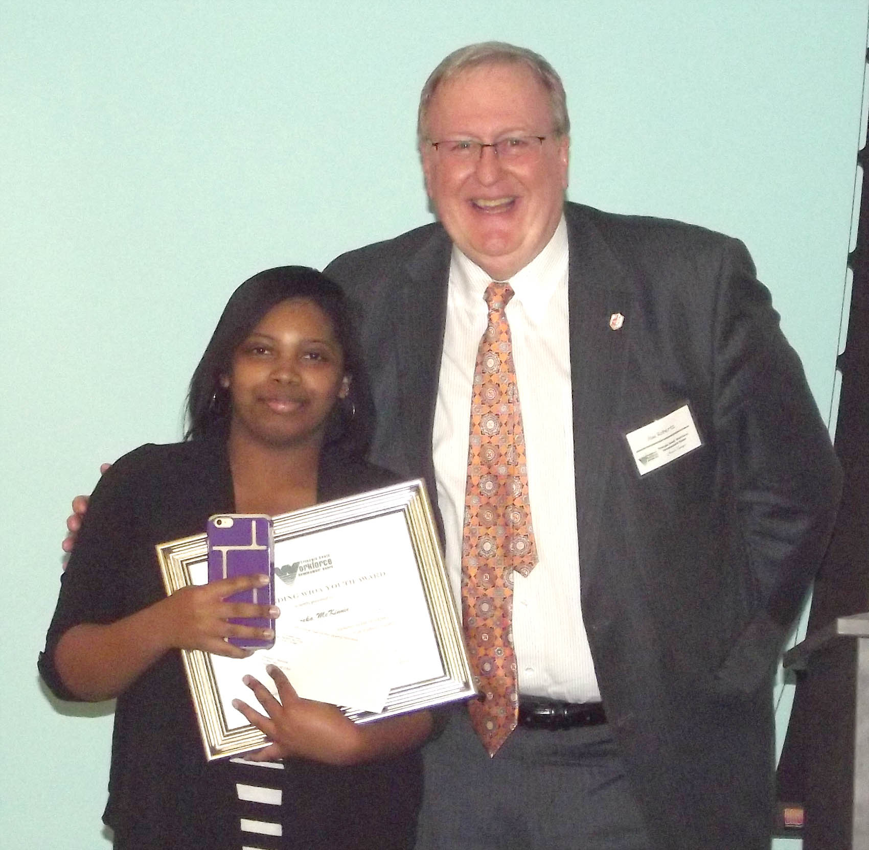 Click to enlarge,  Shareka McKinnie, of Harnett County, received the Outstanding WIOA Out of School Youth Award at the 7th Annual Triangle South Workforce Development Board (TSWDB) Awards Banquet held Wednesday, Dec. 5, at the Central Carolina Community College Harnett Health Sciences Center in Lillington. Presenting the award was Jim Roberts, TSWDB Member.