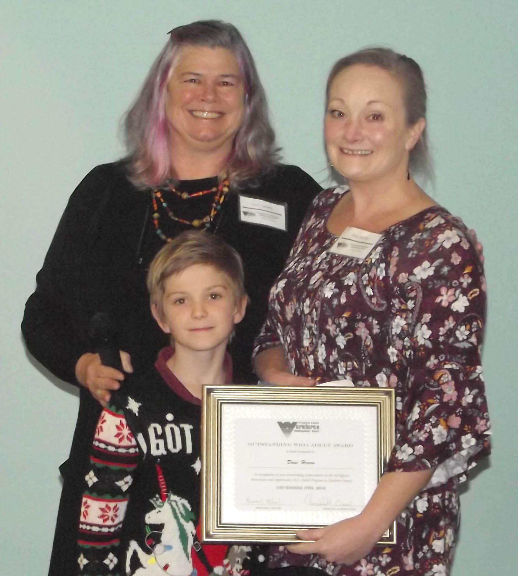 Click to enlarge,  Dani Hearn, of Chatham County, pictured with her son, received the Outstanding WIOA Adult Award at the 7th Annual Triangle South Workforce Development Board (TSWDB) Awards Banquet held Wednesday, Dec. 5, at the Central Carolina Community College Harnett Health Sciences Center in Lillington. Presenting the award was Vicki Newell, TSWDB Member.