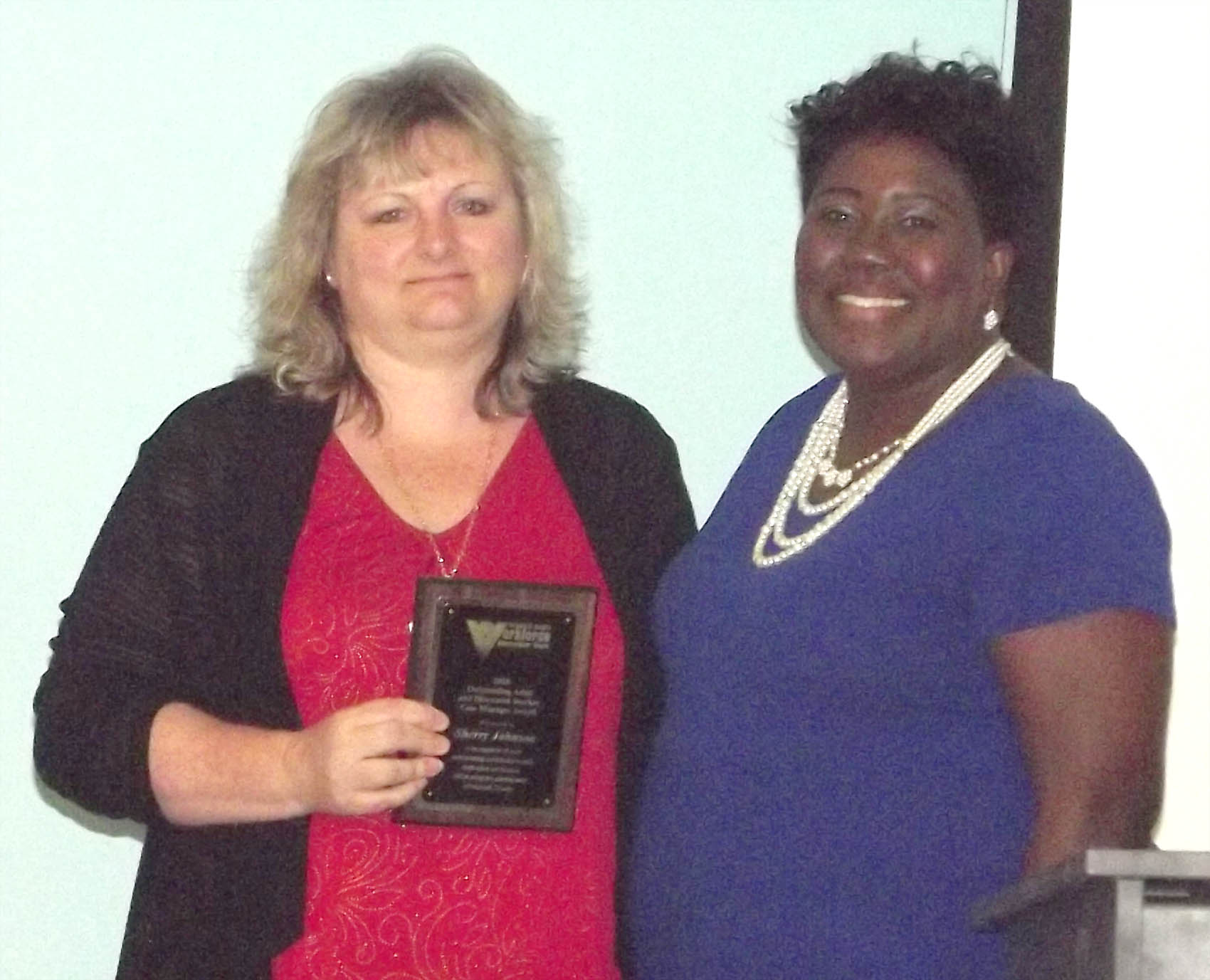 Click to enlarge,  Sherry Johnson, of Harnett County, received the Outstanding Adult/Dislocated Worker Case Manager Award at the 7th Annual Triangle South Workforce Development Board (TSWDB) Awards Banquet held Wednesday, Dec. 5, at the Central Carolina Community College Harnett Health Sciences Center in Lillington. Presenting the award was Kim Shaw, TSWDB Adult Services Coordinator.