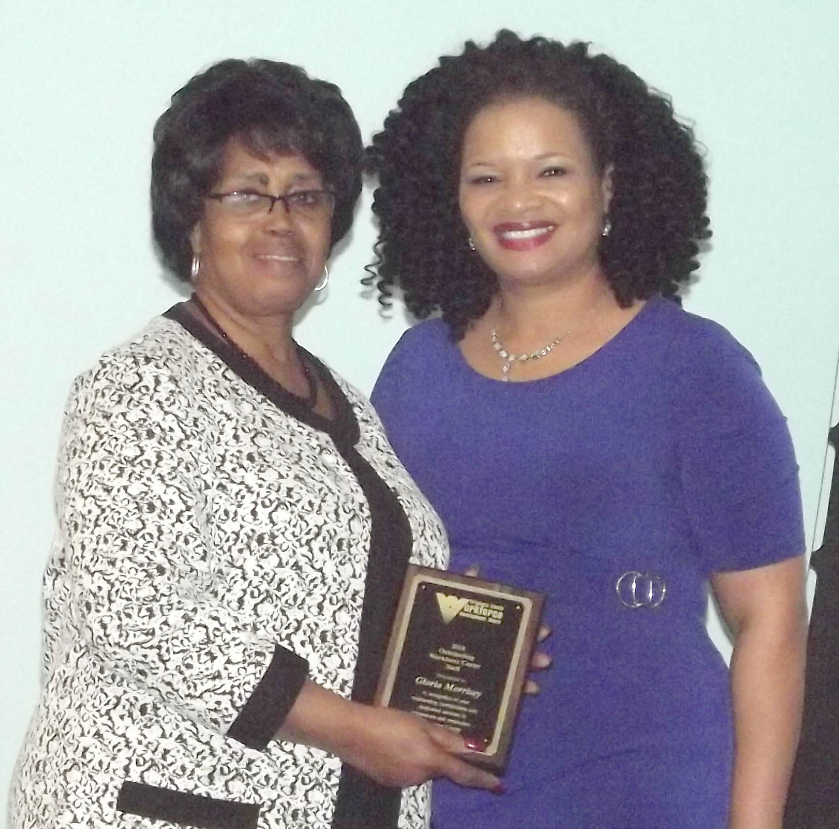 Click to enlarge,  Gloria Morrisey, of Sampson County, received the Outstanding Workforce Center Staff Award at the 7th Annual Triangle South Workforce Development Board (TSWDB) Awards Banquet held Wednesday, Dec. 5, at the Central Carolina Community College Harnett Health Sciences Center in Lillington. Presenting the award was Rosalind Cross, TSWDB Director.