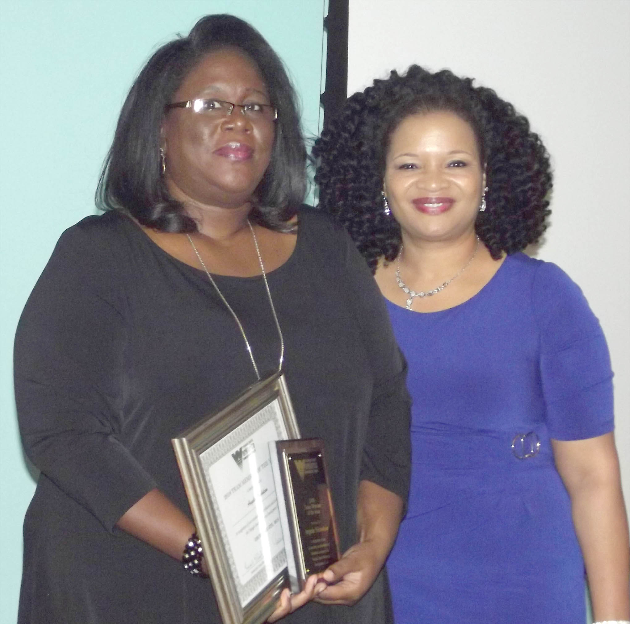 Click to enlarge,  Angela Nicholson received the Team Member of the Year Award at the 7th Annual Triangle South Workforce Development Board (TSWDB) Awards Banquet held Wednesday, Dec. 5, at the Central Carolina Community College Harnett Health Sciences Center in Lillington. Presenting the award was Rosalind Cross, TSWDB Director.