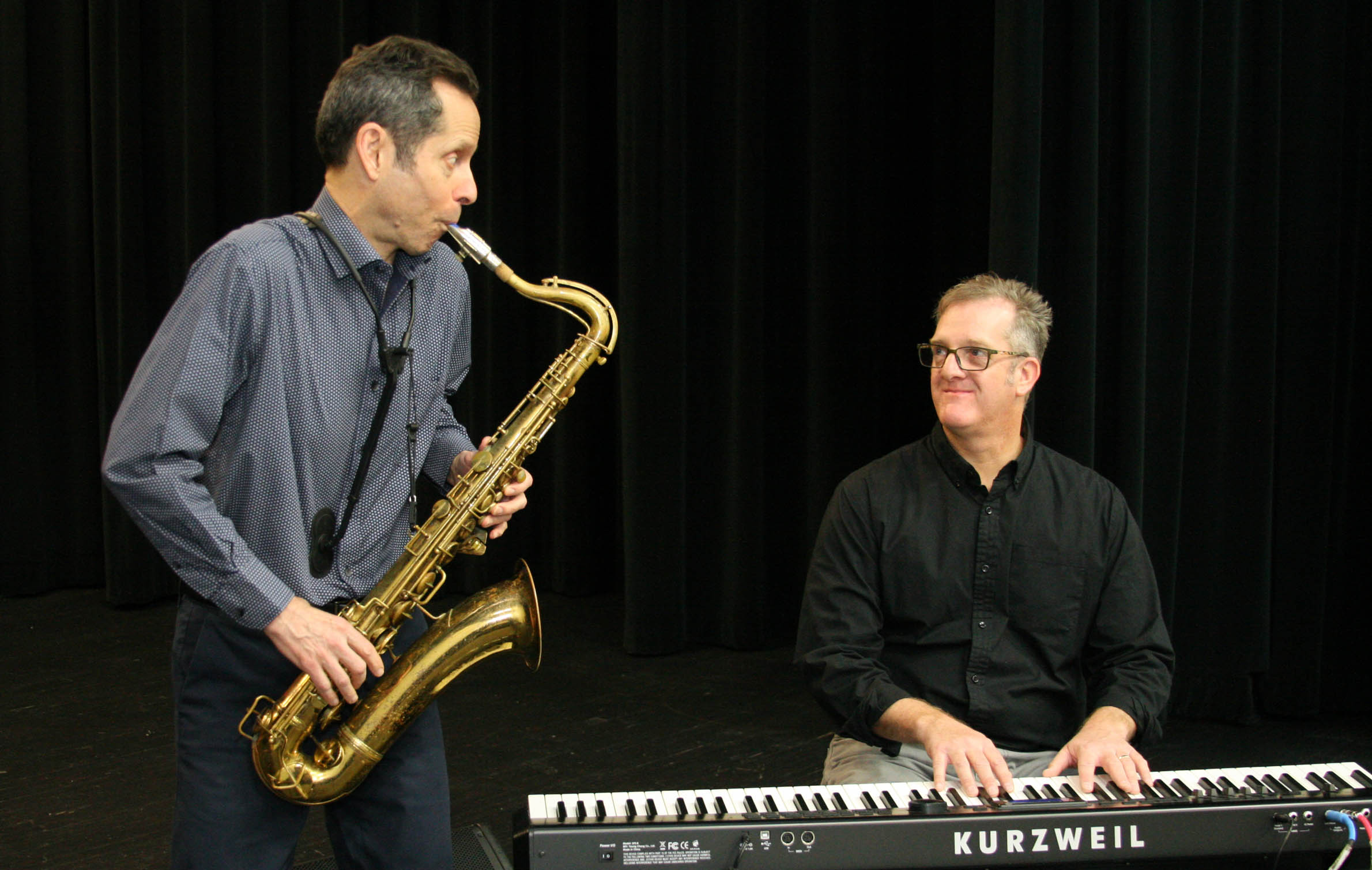 "Click to enlarge,  Gregg Gelb, left, and Steve Anderson improvise a few bars after ""The Age of Jazz,"" their improvisational concert for students at Central Carolina Community College."