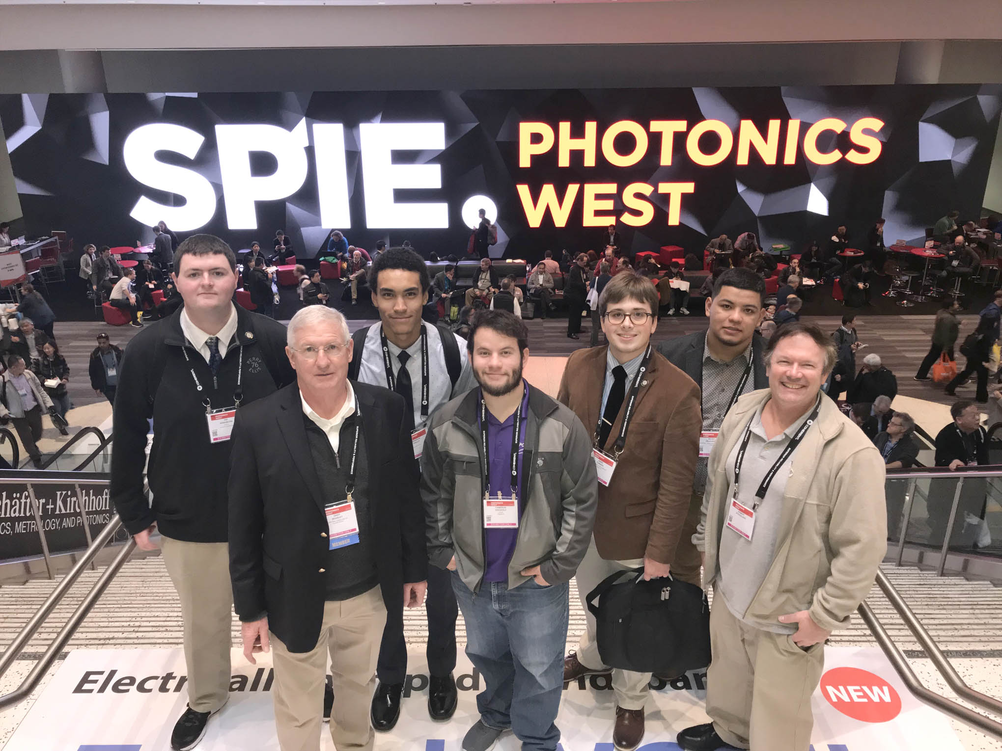 Click to enlarge,  Second-year students in the Laser and Photonics Technology program at Central Carolina Community College's Harnett Main Campus attended the 2019 SPIE Photonics West Convention in San Francisco. Pictured are, left to right: Ian Washburn, Gary Beasley (Lead Instructor), Brandon Pasley, Cameron Wiedholz, Jamie Turner, Kilvet Zalavarria, and Robert Strickland.