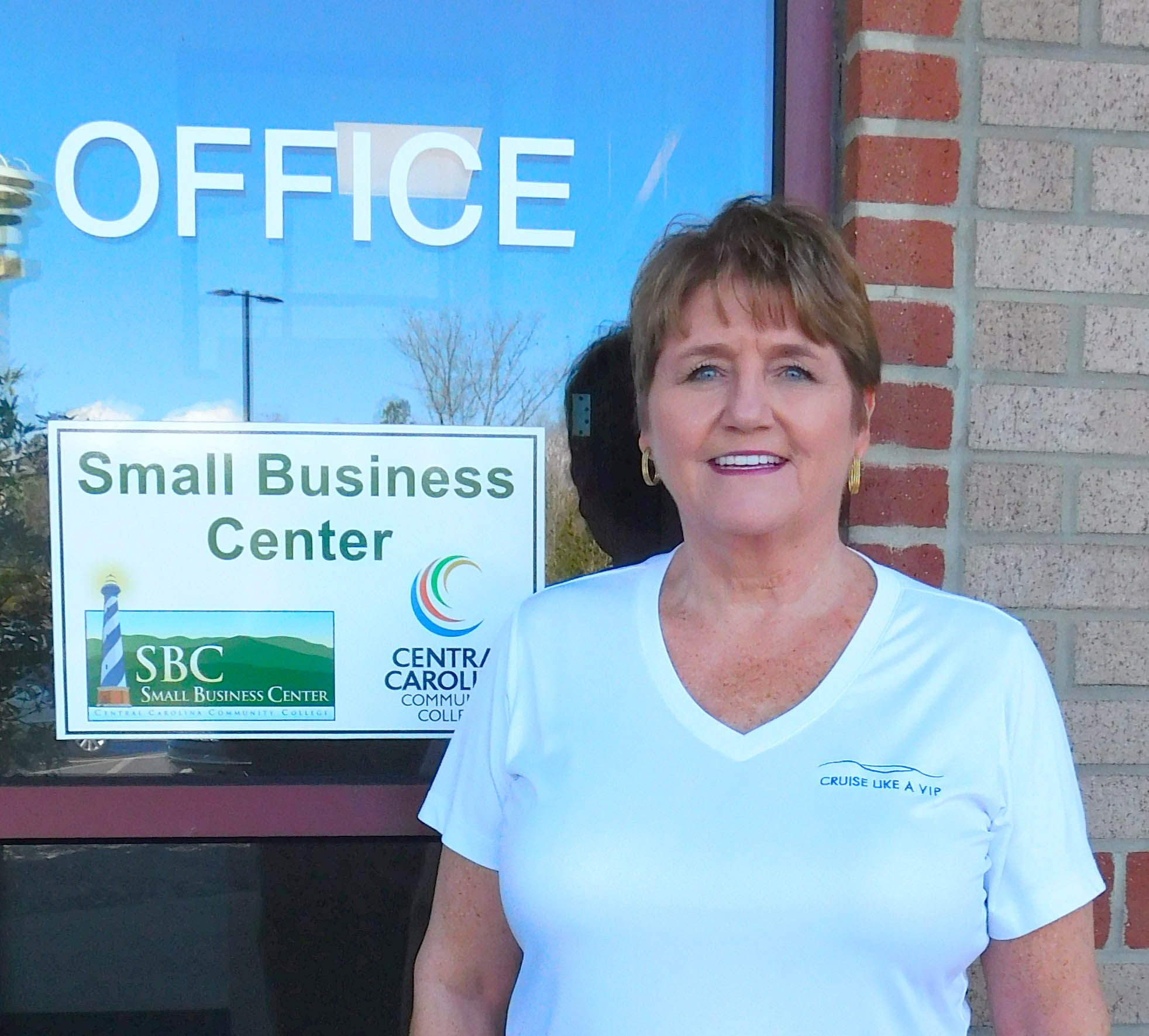 Click to enlarge,  Travel professional Malynda Mize (pictured here) credits much of her success to assistance she received free of charge from Terri Brown, coordinator of the Lee County Small Business Center at Central Carolina Community College.