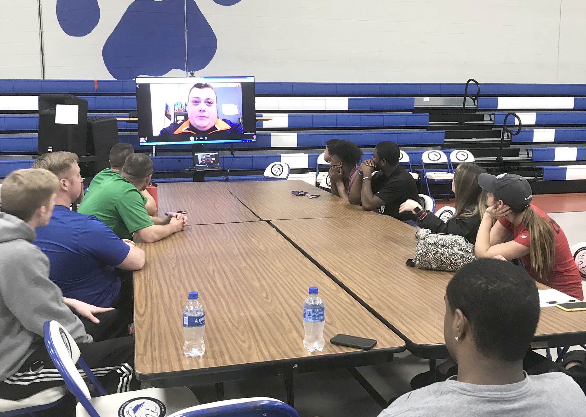 Click to enlarge,  Central Carolina Community College Health & Fitness Science students visit with Sanford native and University of Virginia women's basketball athletic trainer Craig Oates, who conducted a Question and Answer session with the CCCC students and provided them a tour of the facilities via webcam. To learn more about the CCCC Health & Fitness Science program, visit www.cccc.edu/curriculum/majors/hfs/.