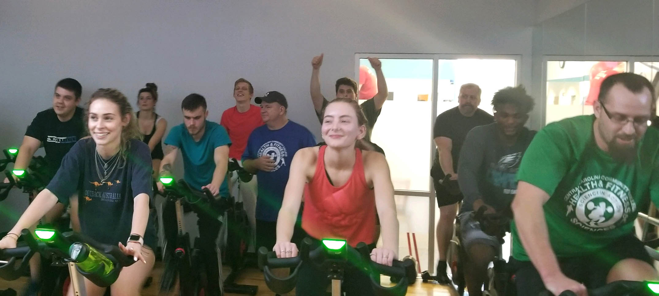 Click to enlarge,  Central Carolina Community College Health and Fitness Science students participate in stationary bike exercises at Sanford's Ingram Family YMCA.
