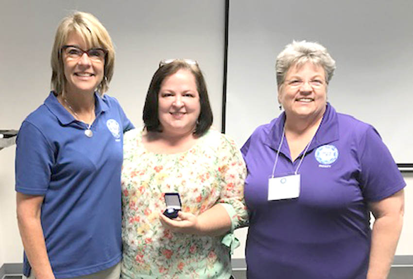Click to enlarge,  Central Carolina Community College Nursing Instructor Dixie Holden (center) visits with Diane Mathe (left) of CAE Healthcare and Dr. Carol Durham (right), Director, Education-Innovation-Simulation Learning Environment, UNC School of Nursing. Mathe and Durham were mentors and conducted training when Holden received her International Nursing Association for Clinical Simulation and Learning Simulation Fellowship.