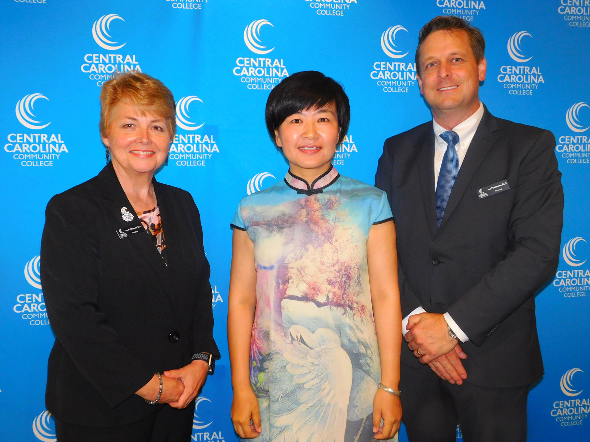 Click to enlarge,  Central Carolina Community College hosted a Ninth Anniversary and farewell honoring Yuehan Ma and the CCCC Confucius Classroom. Yuehan Ma is pictured in center with CCCC President Dr. Lisa M. Chapman at left and CCCC Harnett Provost Dr. Jon Matthews at right.