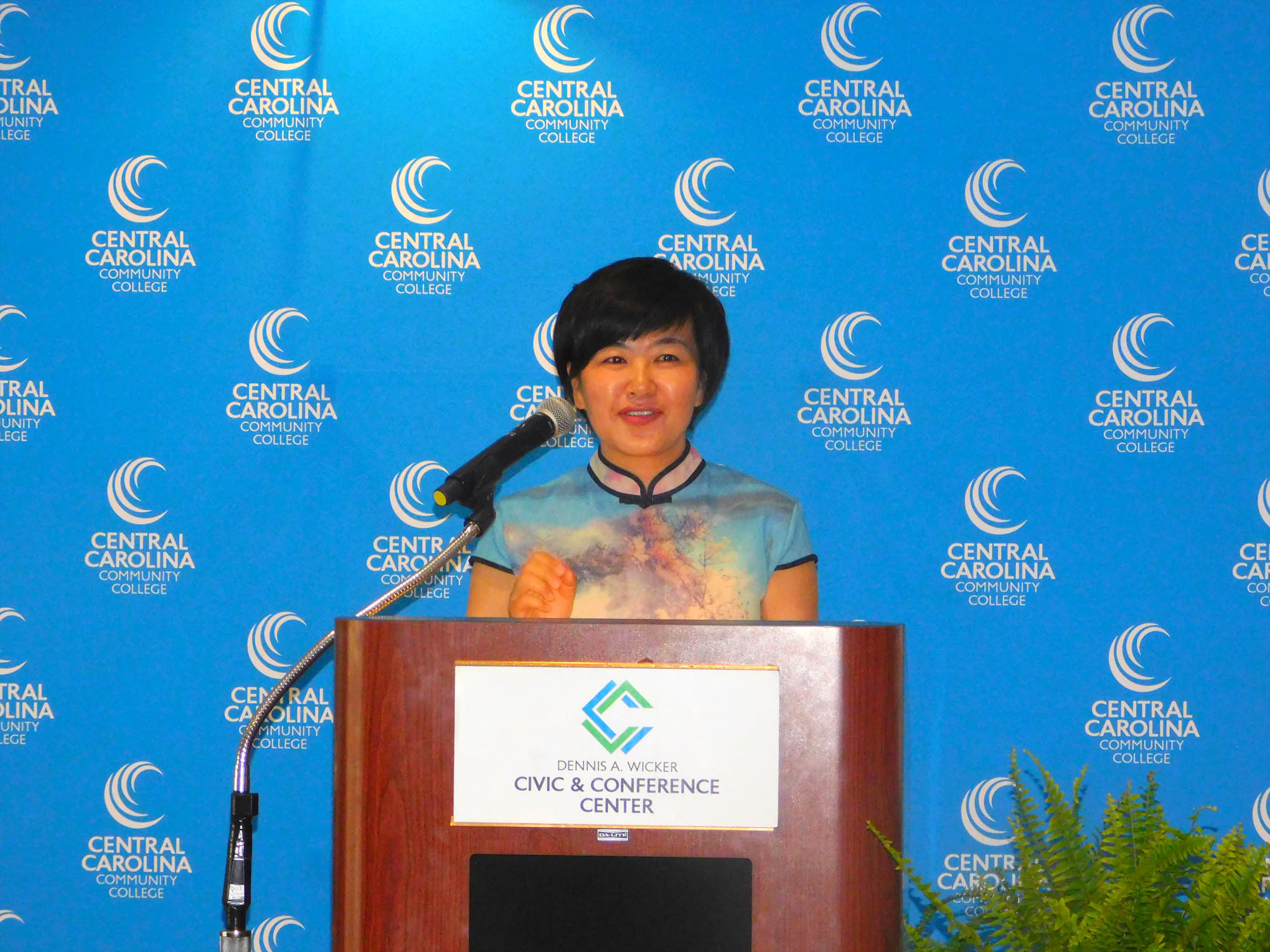 Click to enlarge,  Central Carolina Community College hosted a Ninth Anniversary and farewell honoring Yuehan Ma (pictured here at podium) and the CCCC Confucius Classroom.