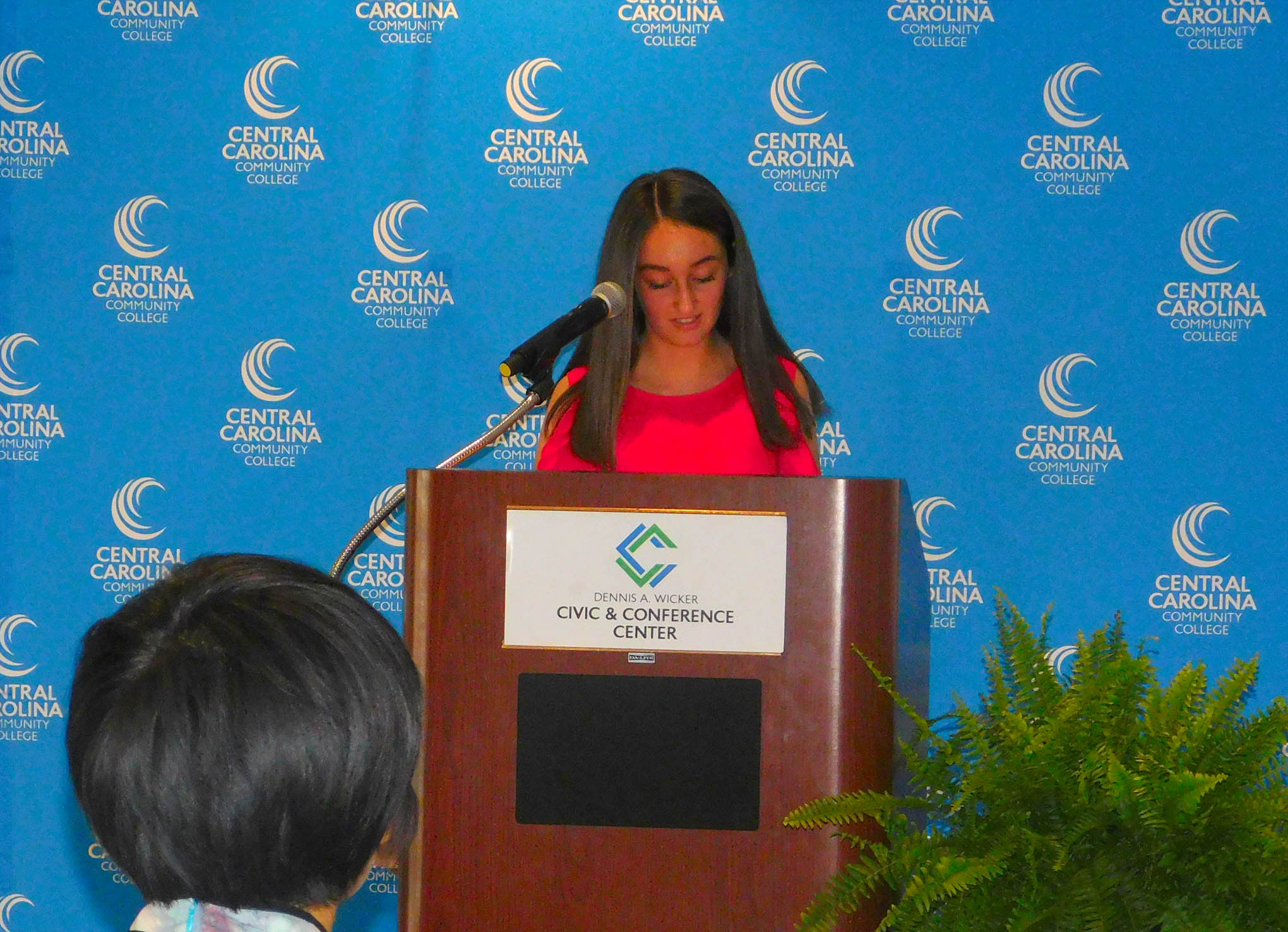 Click to enlarge,  Central Carolina Community College hosted a Ninth Anniversary and farewell honoring Yuehan Ma and the CCCC Confucius Classroom. Here, student Audrey Thomas speaks to the audience.