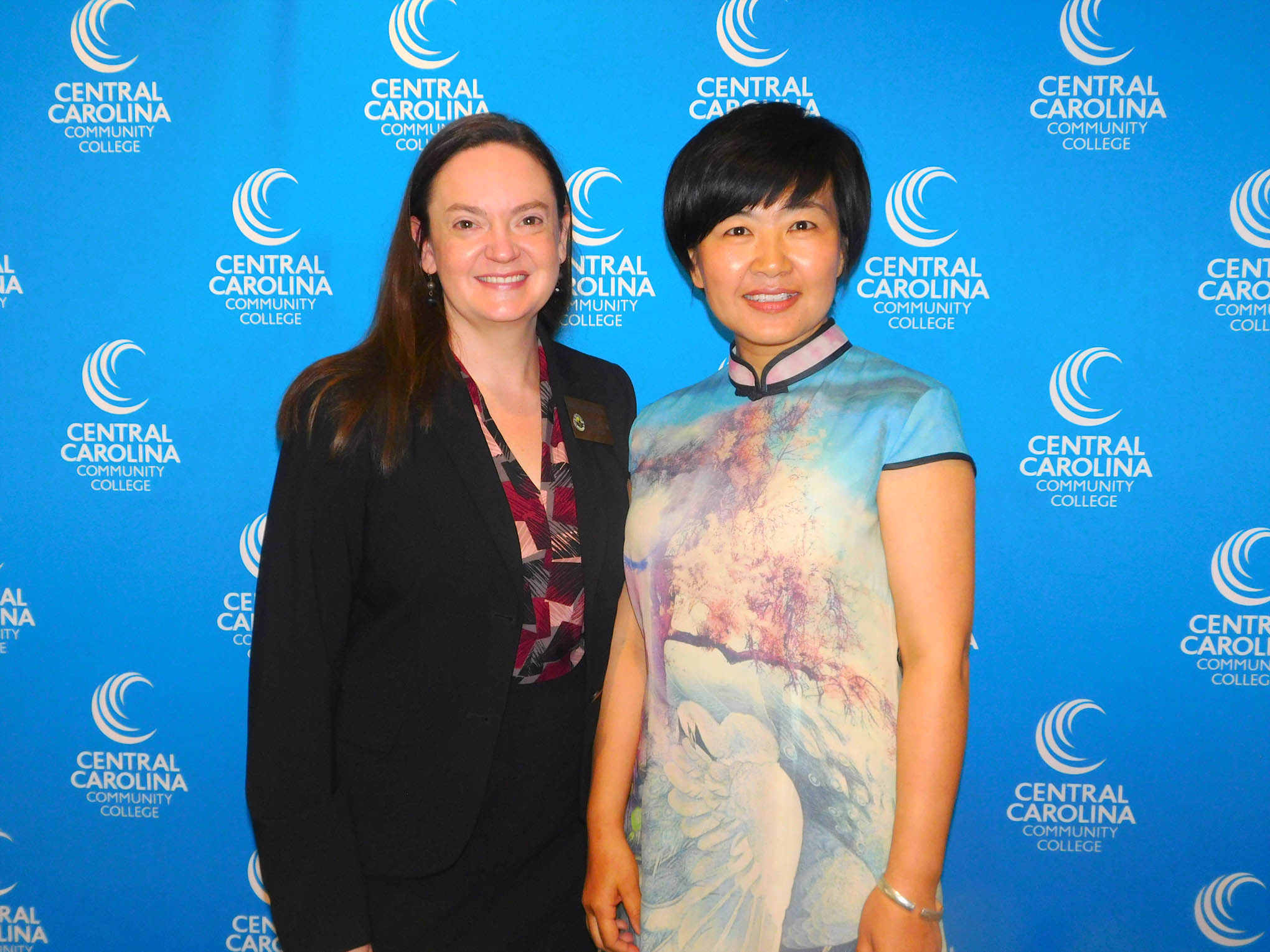 Click to enlarge,  Central Carolina Community College hosted a Ninth Anniversary and farewell honoring Yuehan Ma and the CCCC Confucius Classroom. Yuehan Ma is pictured at right with Sanford Mayor Pro Tem Rebecca Wyhof Salmon.