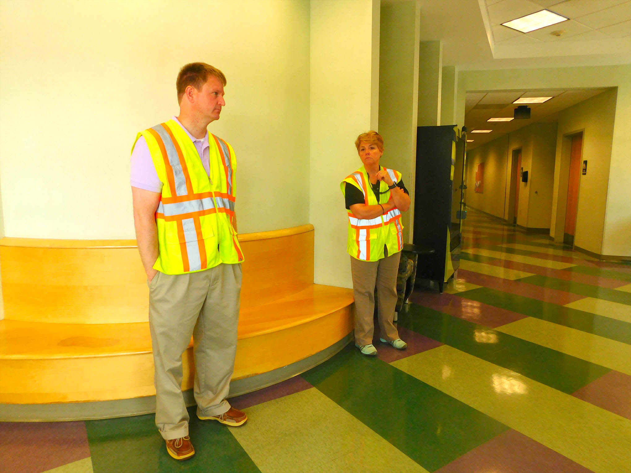 Click to enlarge,  Central Carolina Community College Vice President of Administrative Services Dr. Phillip Price (left) and President Dr. Lisa M. Chapman (right) are in a CCCC Lee Main Campus hallway as observers during a recent active assailant drill.