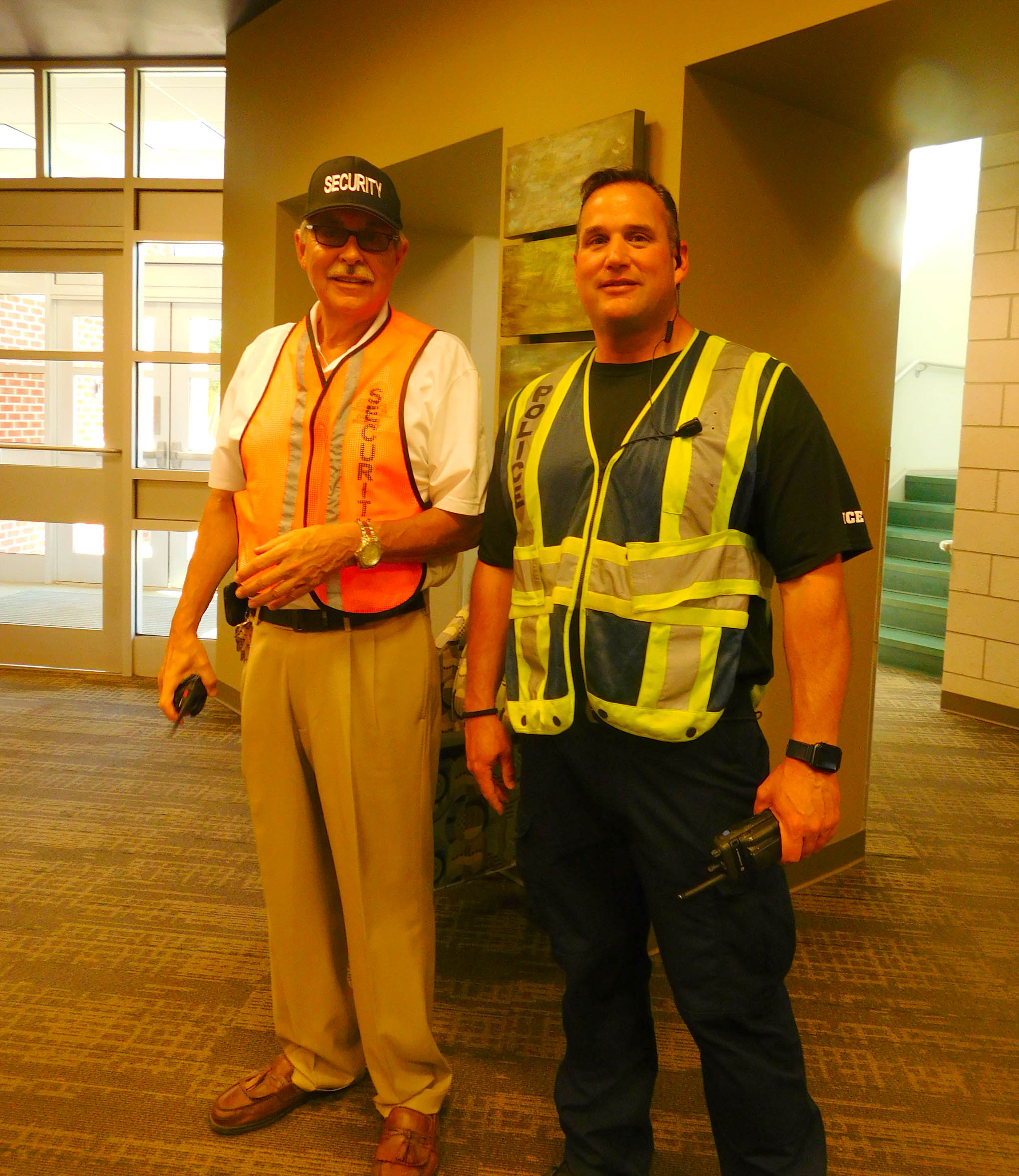 Click to enlarge,  Frank R. Bedoe Sr. (left), Central Carolina Community College Director of Campus Security and Safety, is pictured with a law enforcement official as the recent CCCC active assailant drill was coming to an end.